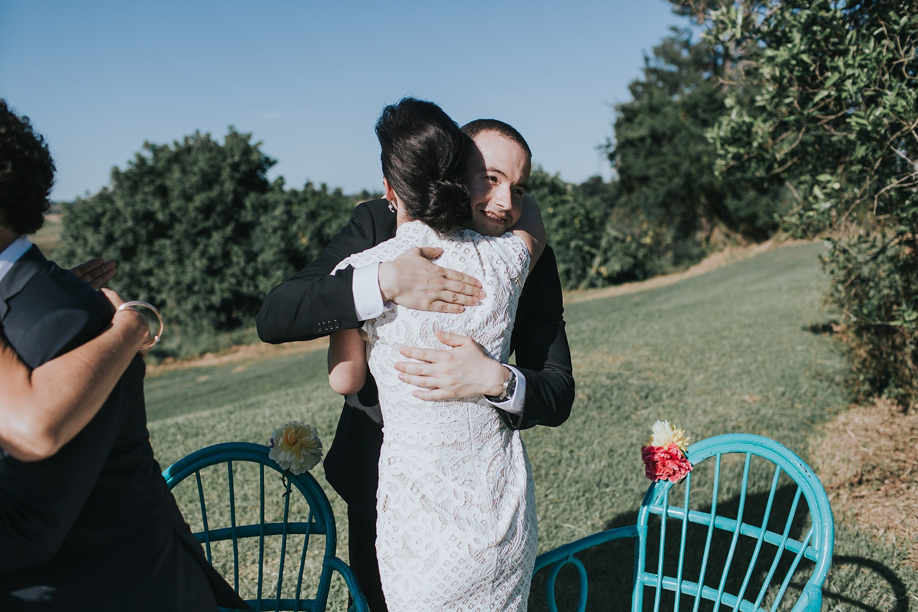 hugs and happy exchanges for the new husband and wife