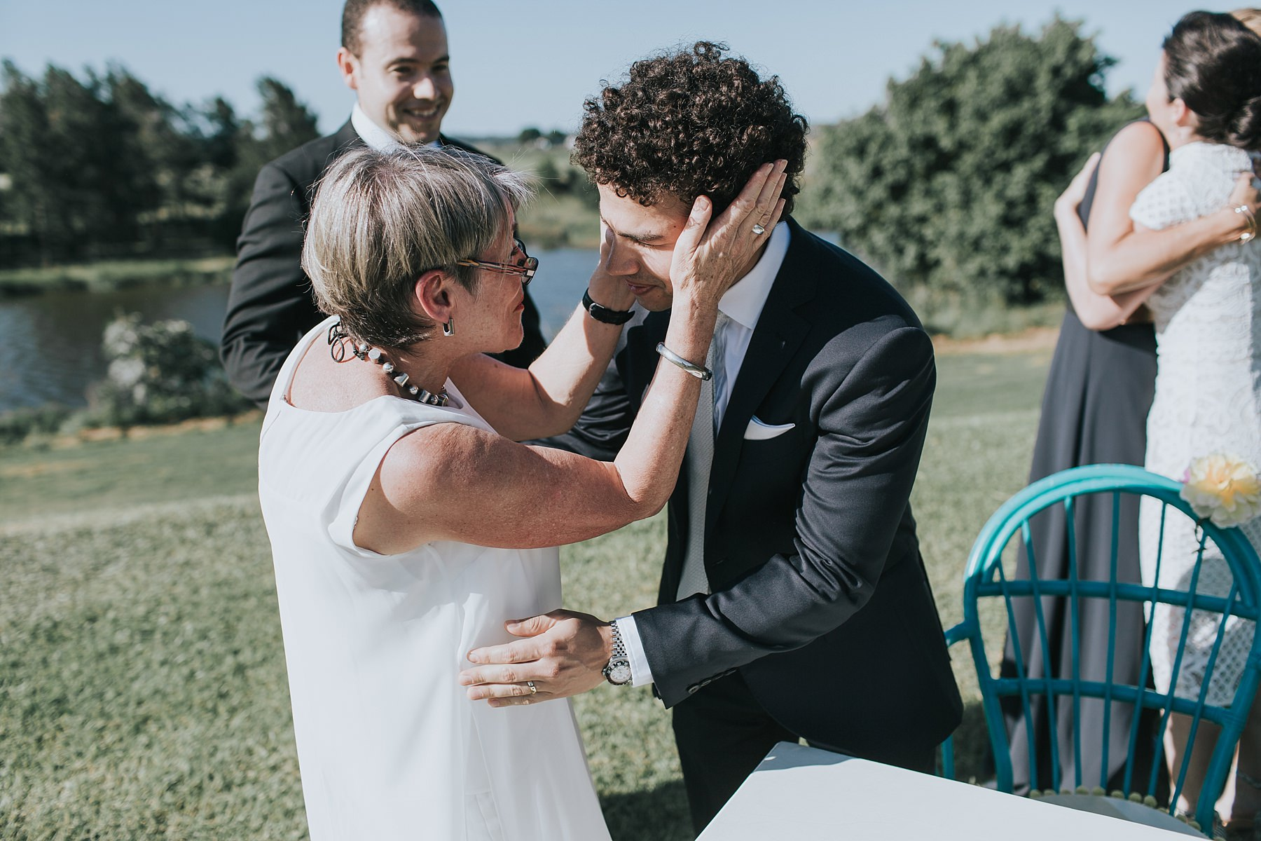 groom congratulated by friends and family on wedding day