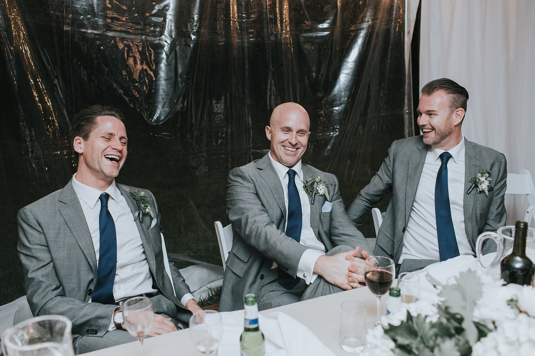 groomsmen in marquee wedding
