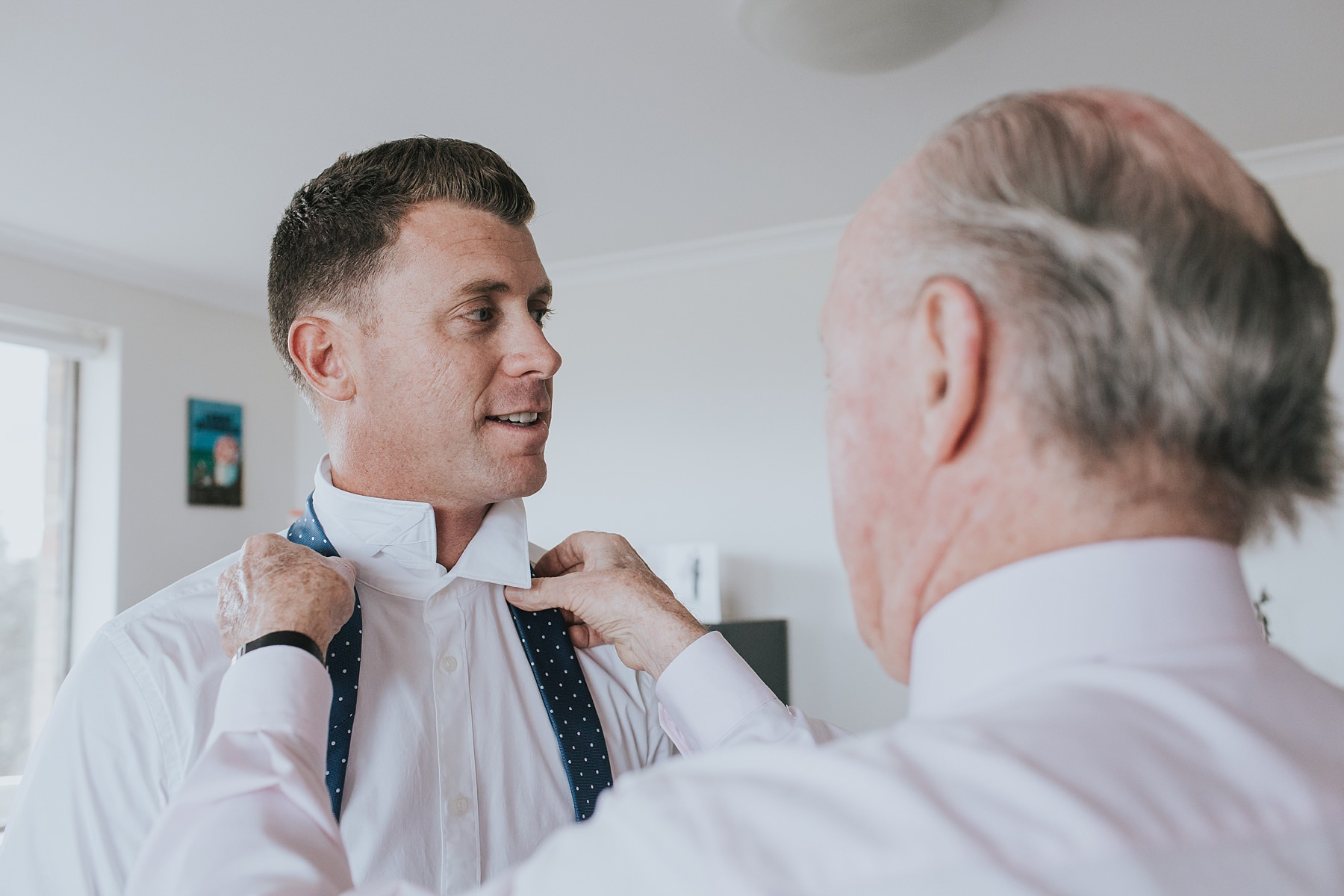 groomsmen getting ready before wedding ceremony