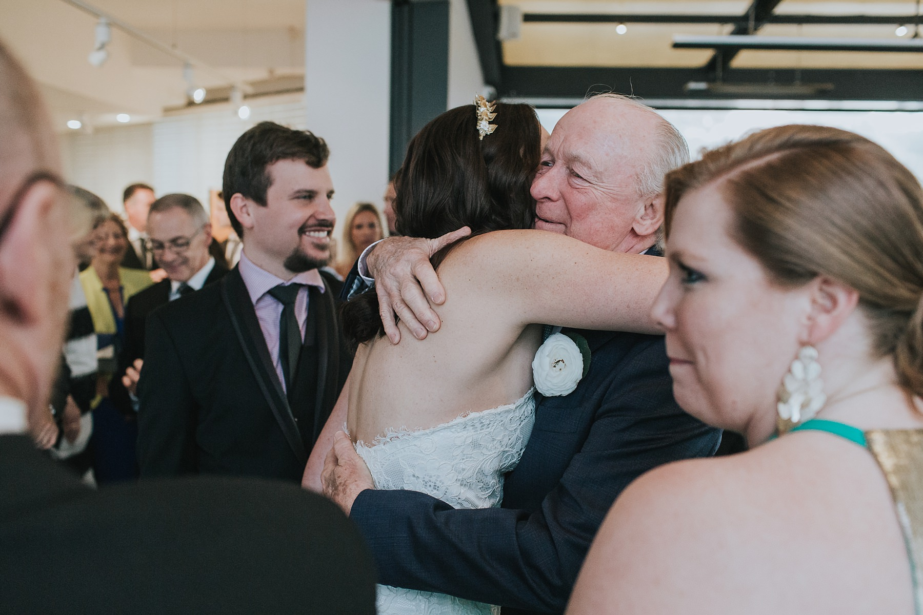 father of the groom congratulates his new daughter
