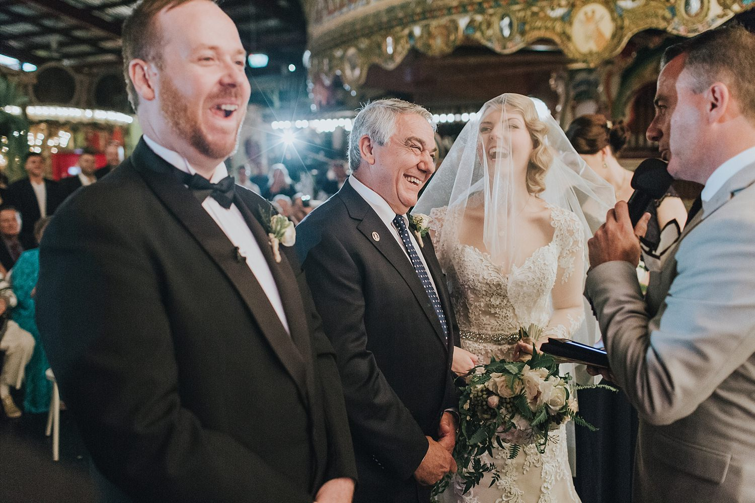 excited father of the bride laughing at sydney wedding ceremony