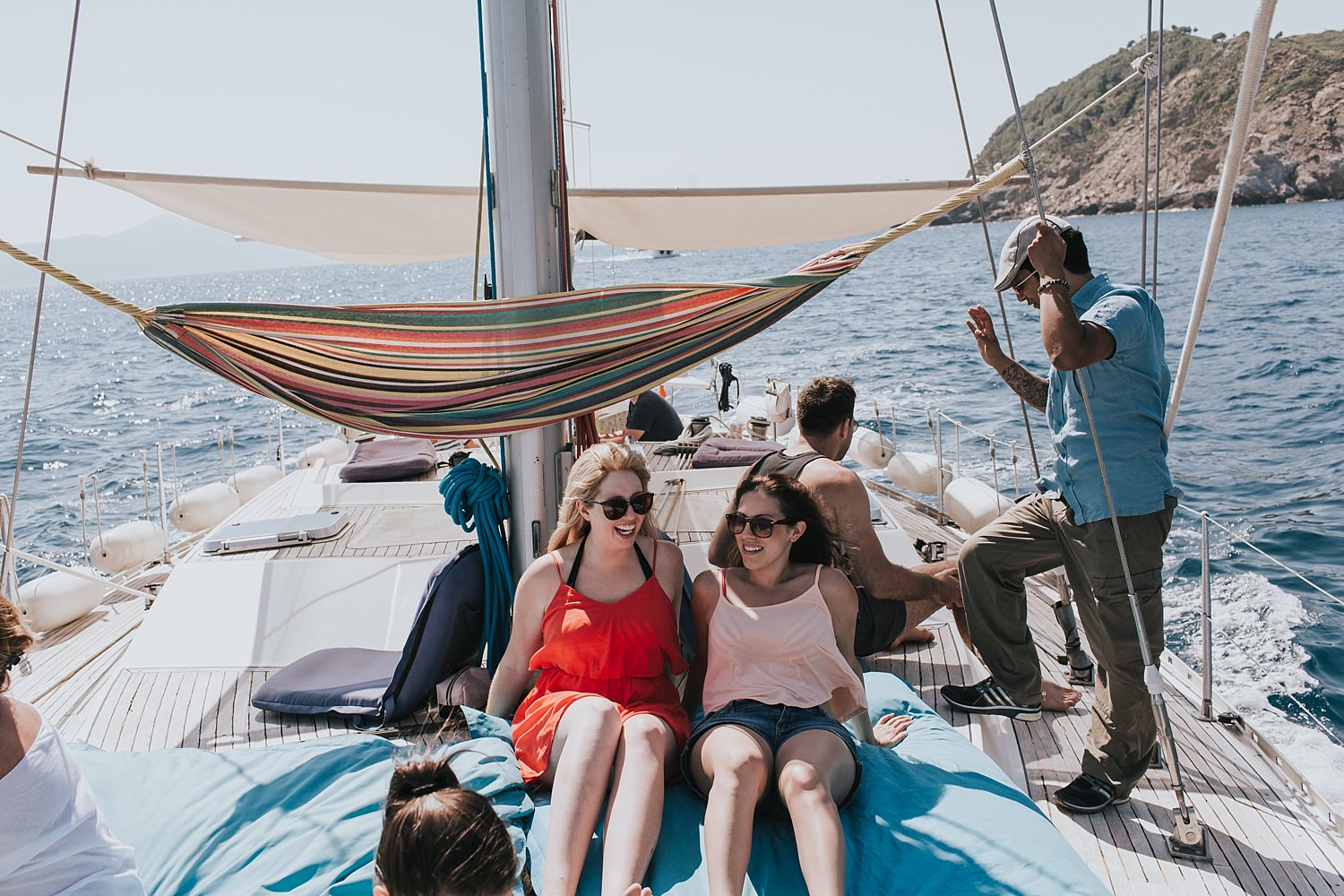bride relaxes with a sailing tour of skiathos