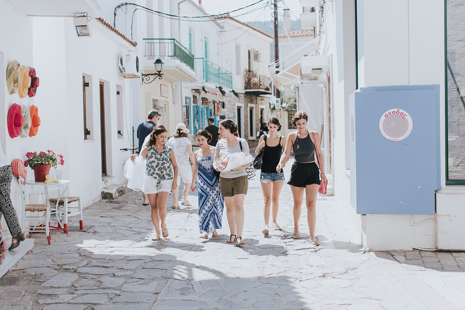 bridesmaids walking down the skiathos main street