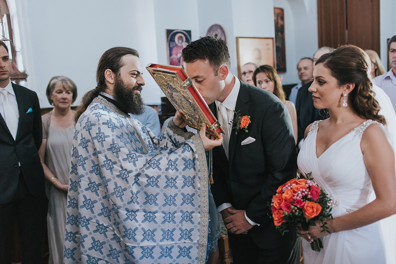 kissing the gospel in greek orthodox wedding