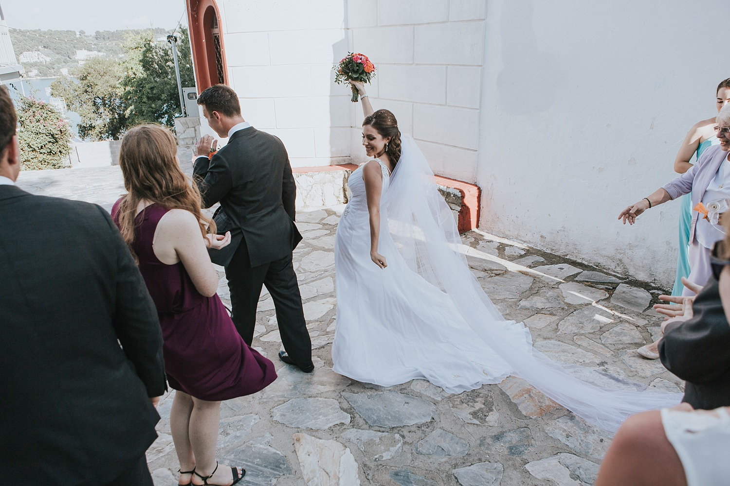 bride walks from the church excited