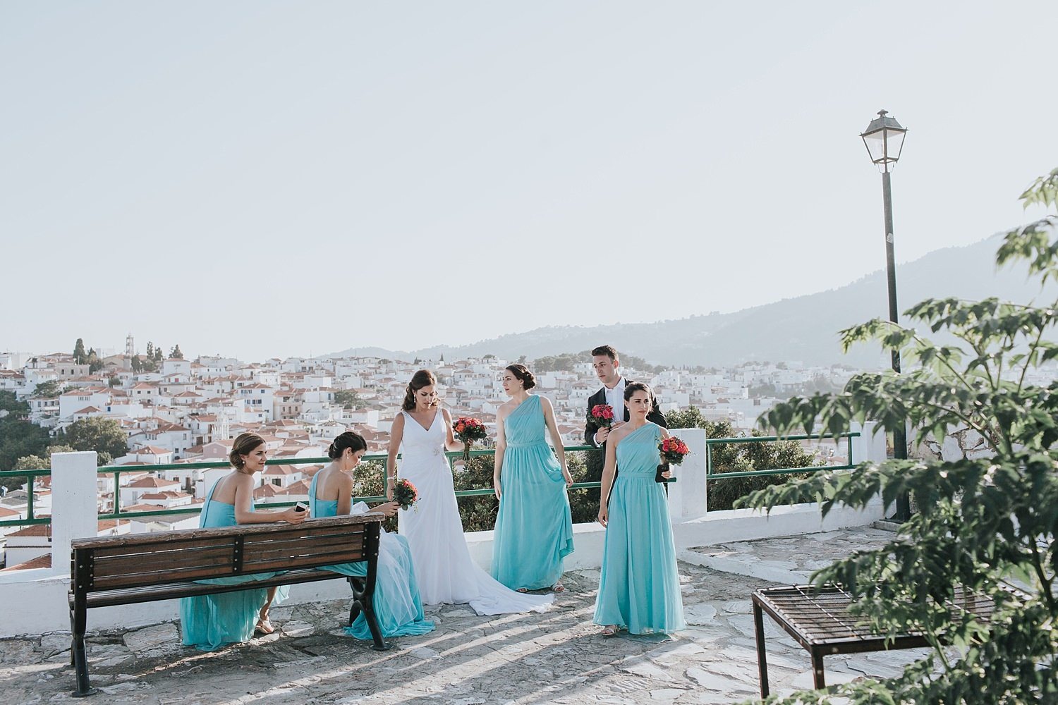 bridal party enjoy the view of skiathos