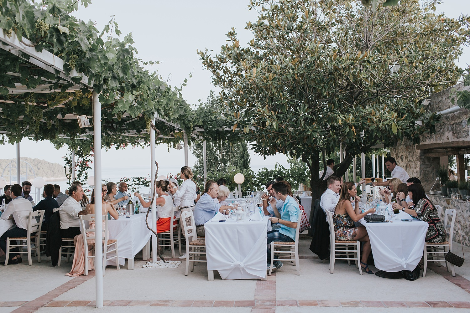 guests seated in skiathos for wedding reception