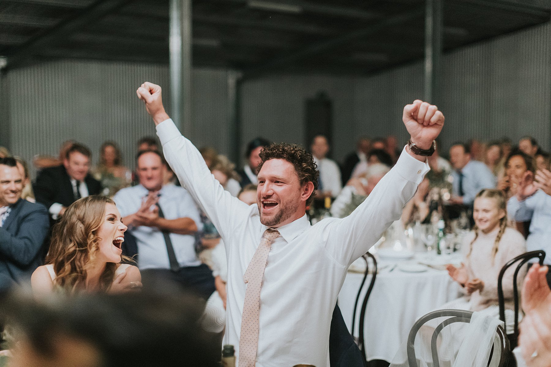 groom punching the air during wedding reception at coonamble