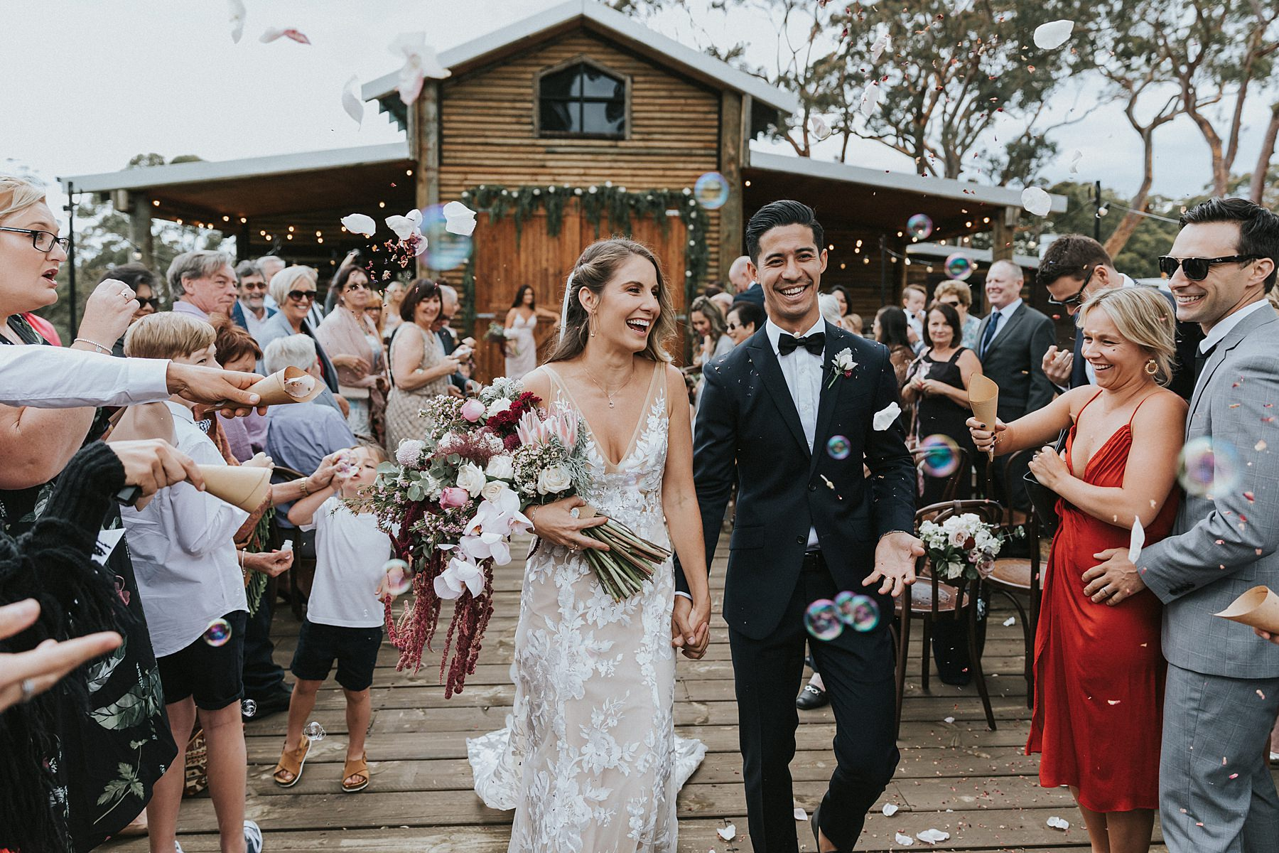 bubbles and confetti at silvergum stables wedding photography