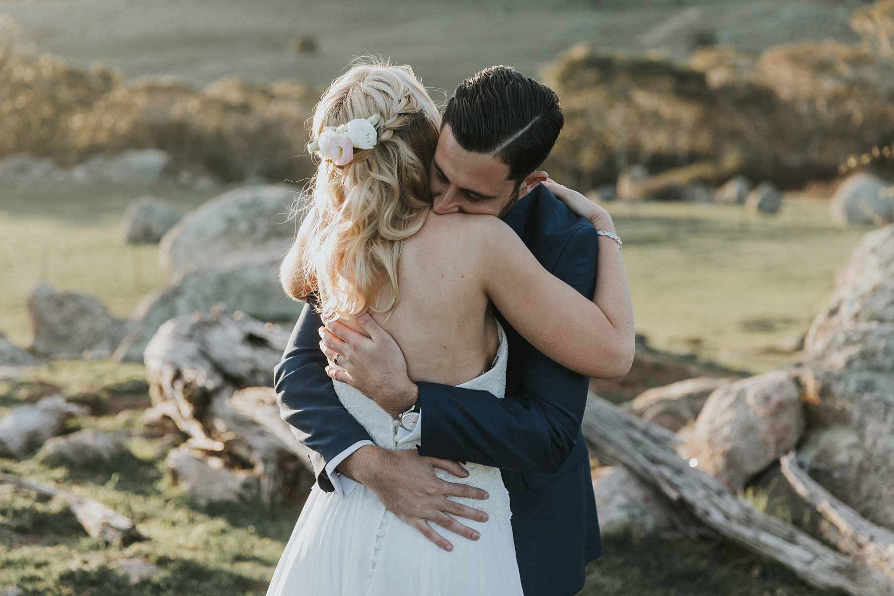 bride and groom embrace at waldara farm during wedding photos