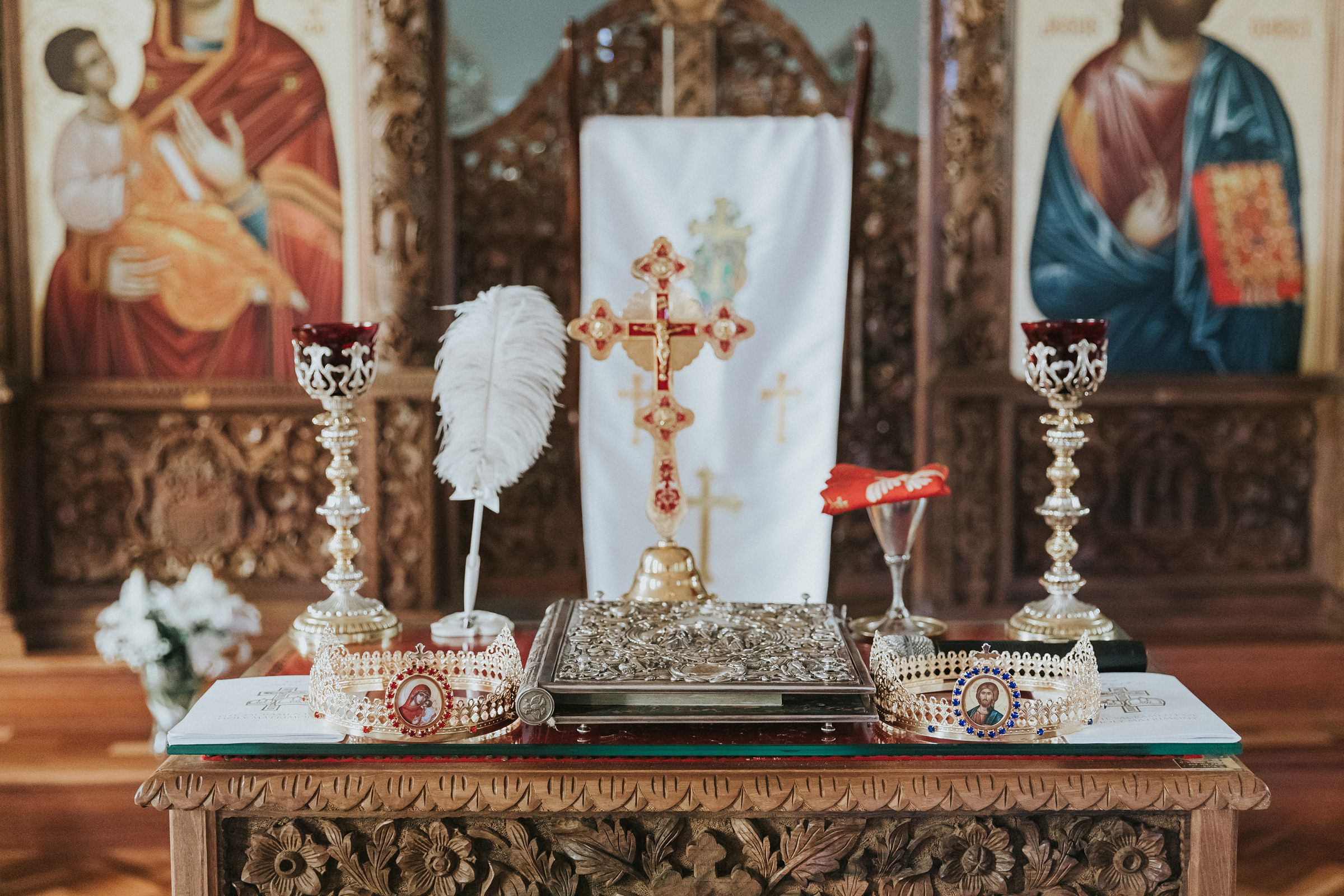 crowns and holy bible during orthodox wedding ceremony