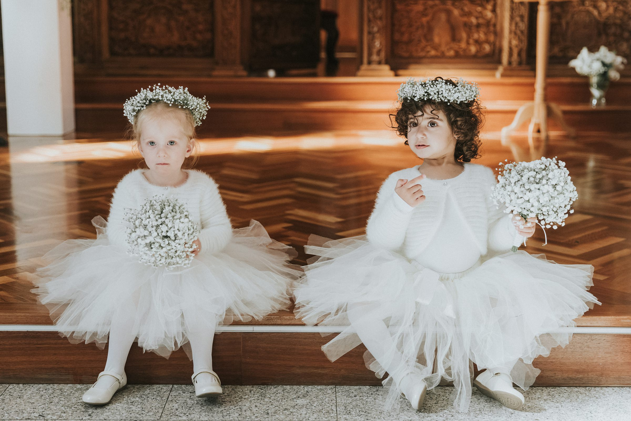 flower girls during wedding ceremony in orthodox church