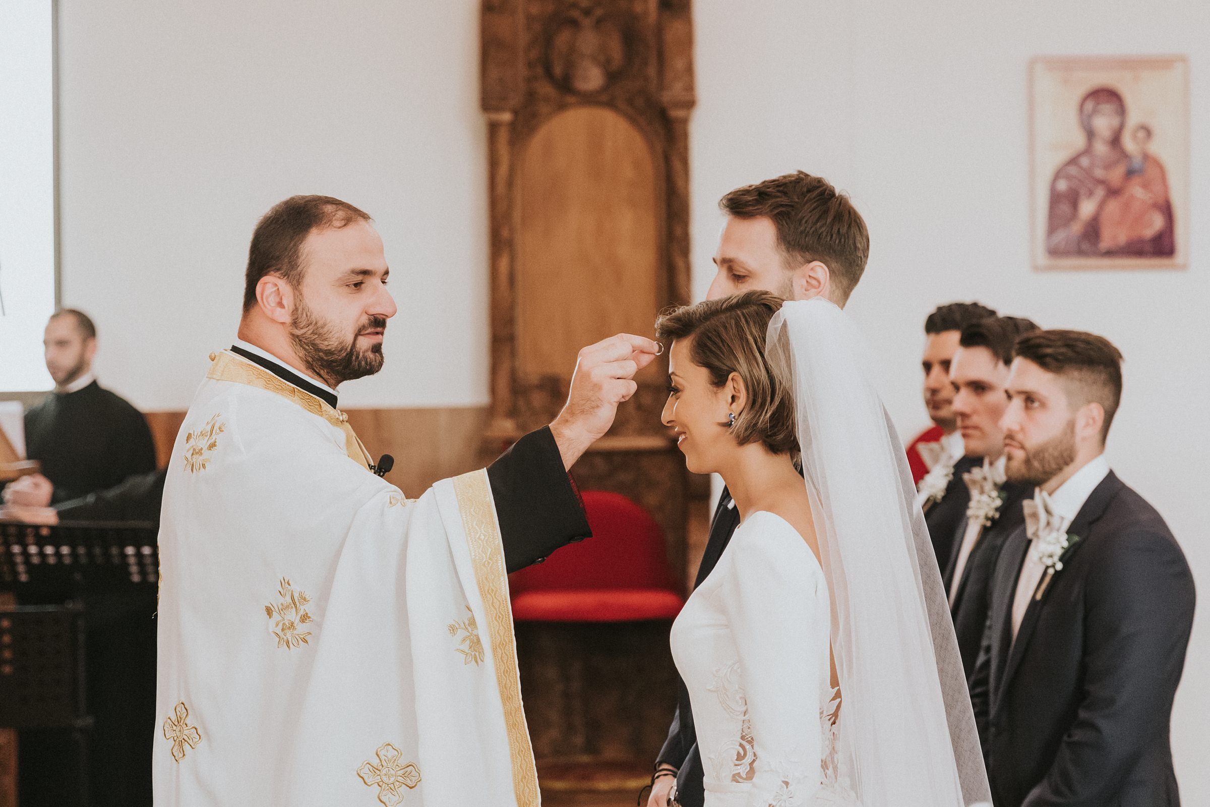 exchanging wedding rings during orthodox wedding ceremony