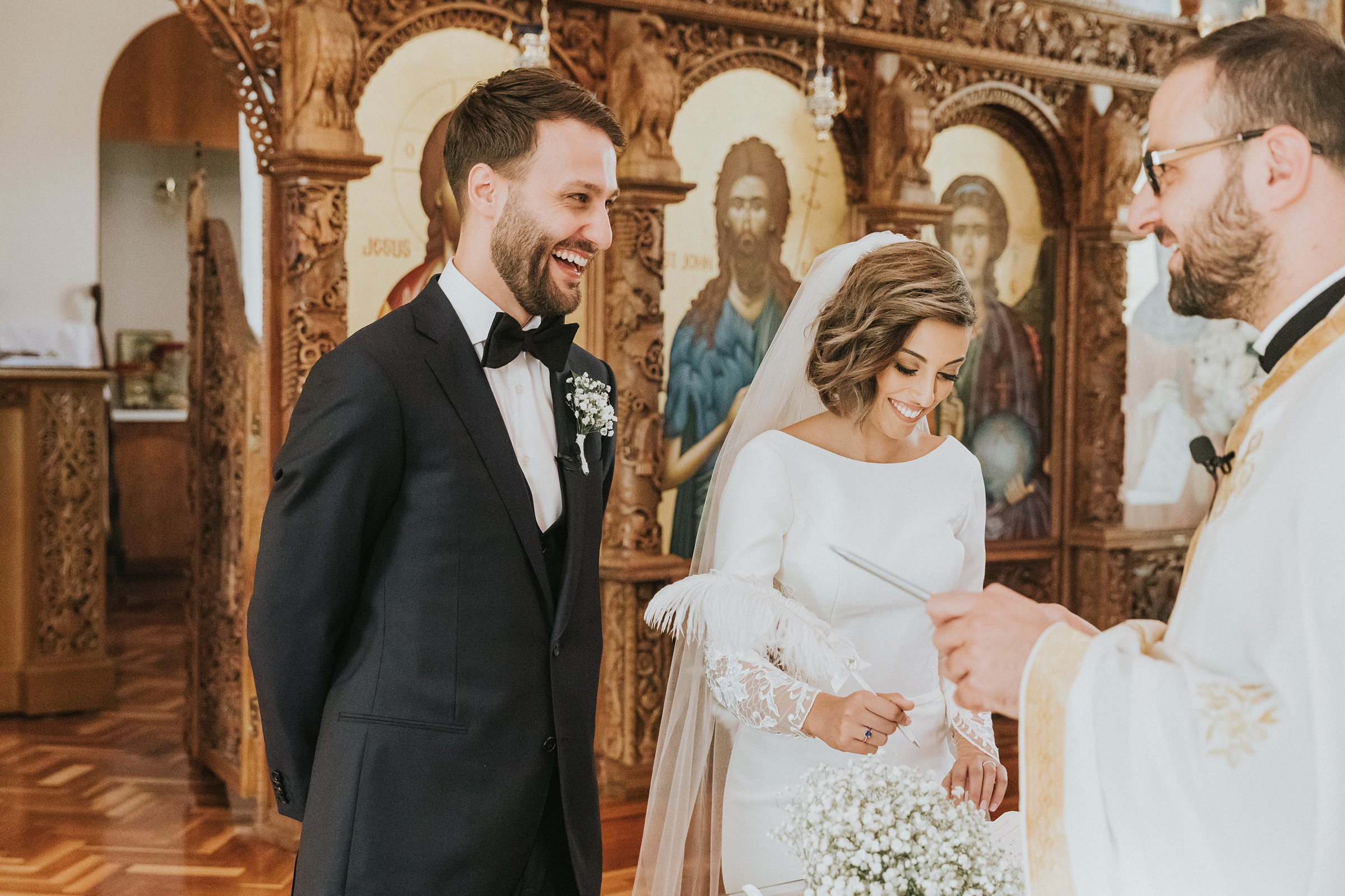candid laughter and happiness at wedding photographed by jonathan david