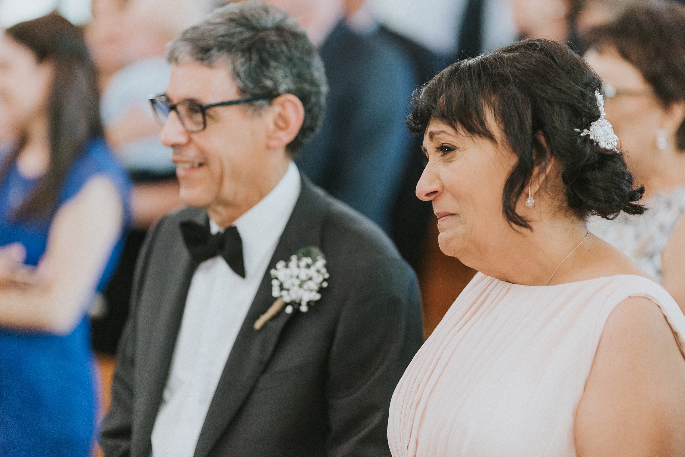 mother of the bride sheds a tear during wedding ceremony