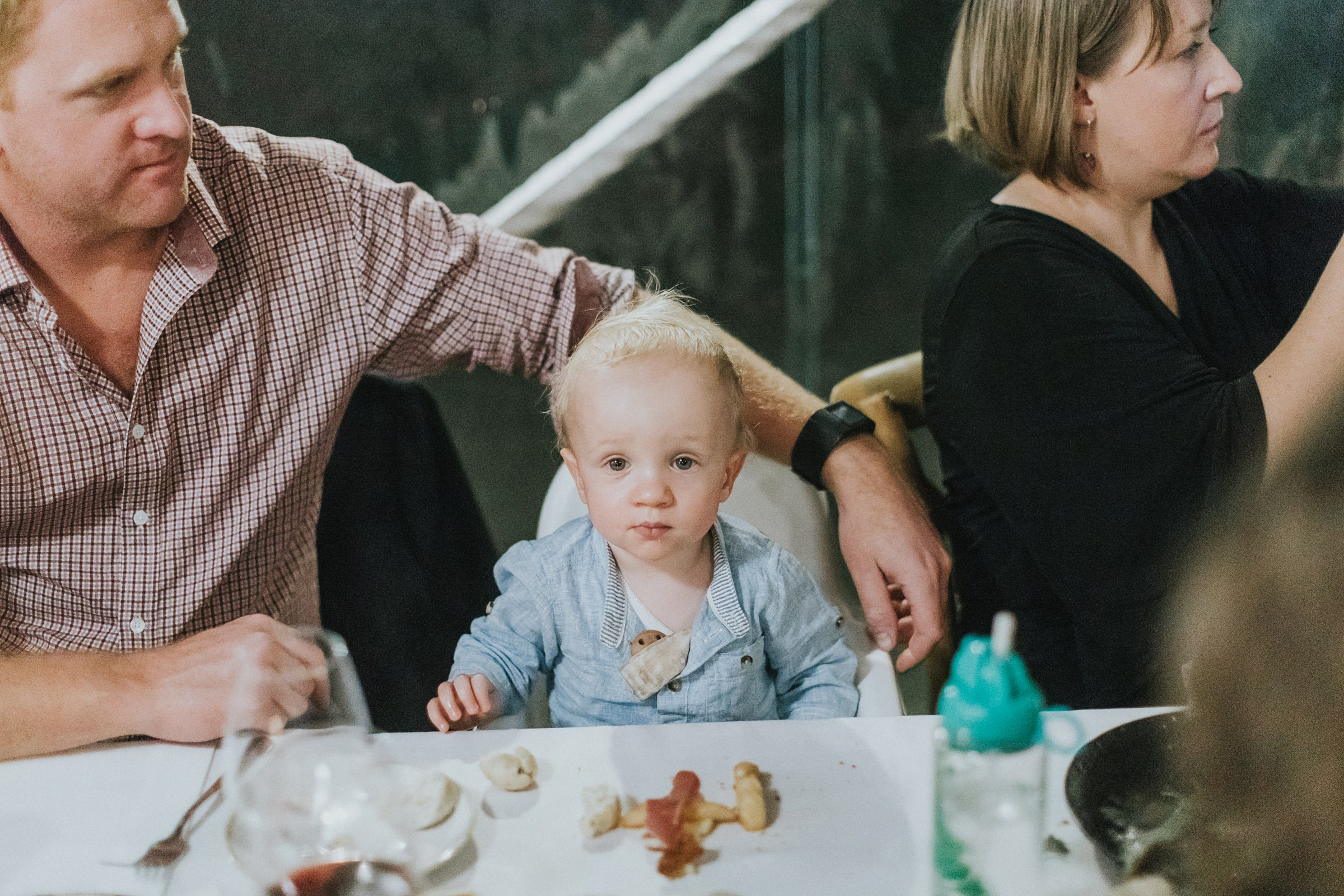 cute baby at wedding reception sitting at table