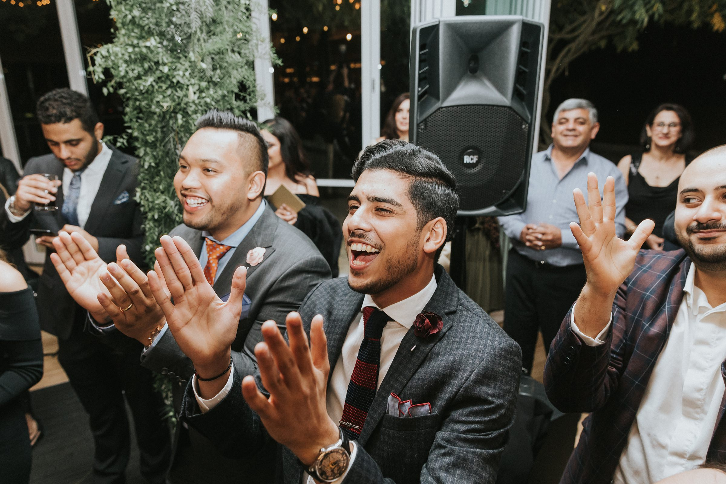 clapping and singing to arabic music during wedding reception in sydney