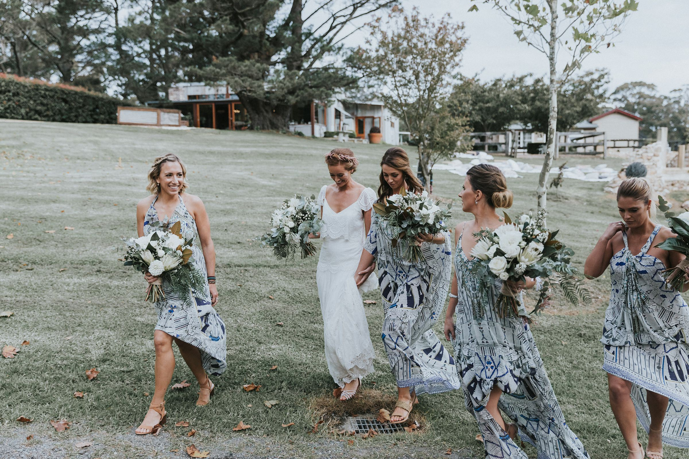 bride and bridesmaids walk to the ceremony