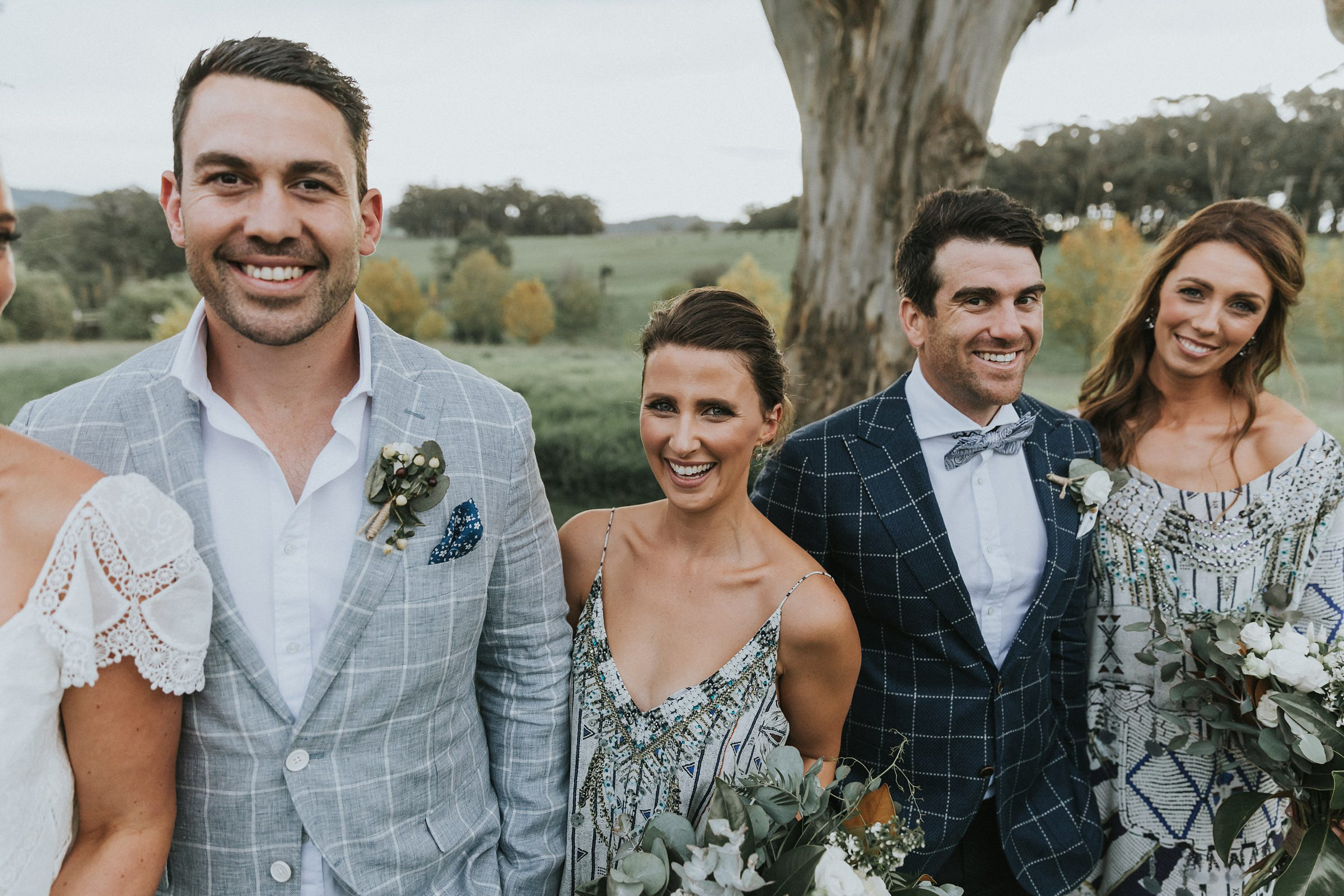 bridal party has fun with portraits at mali brae farm