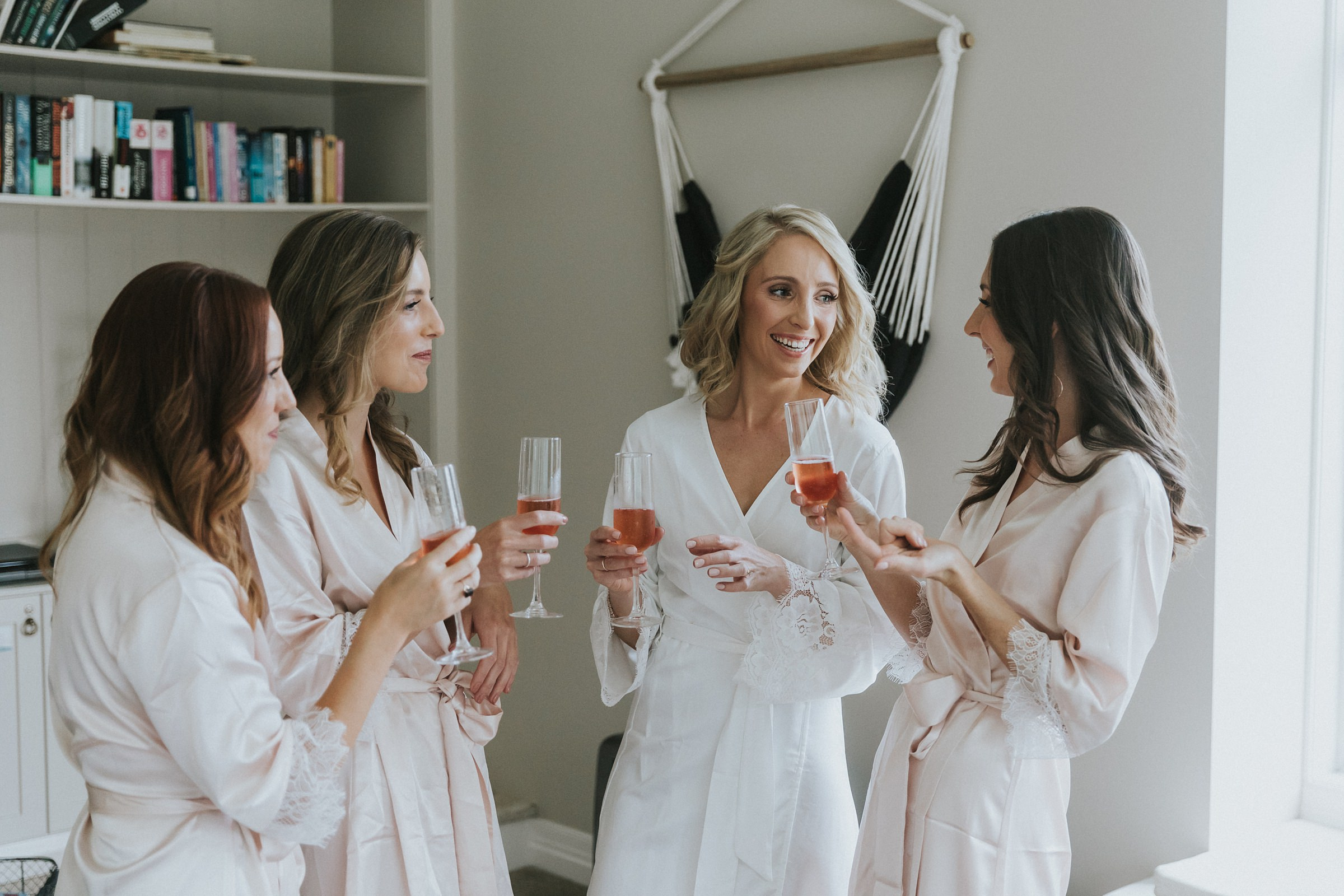 toasting the bride during bridal prep in bowral