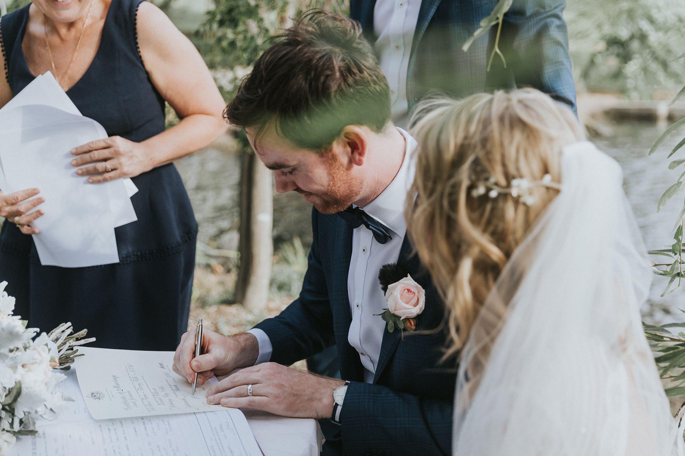 groom signs his life away at kangaroo valley wedding