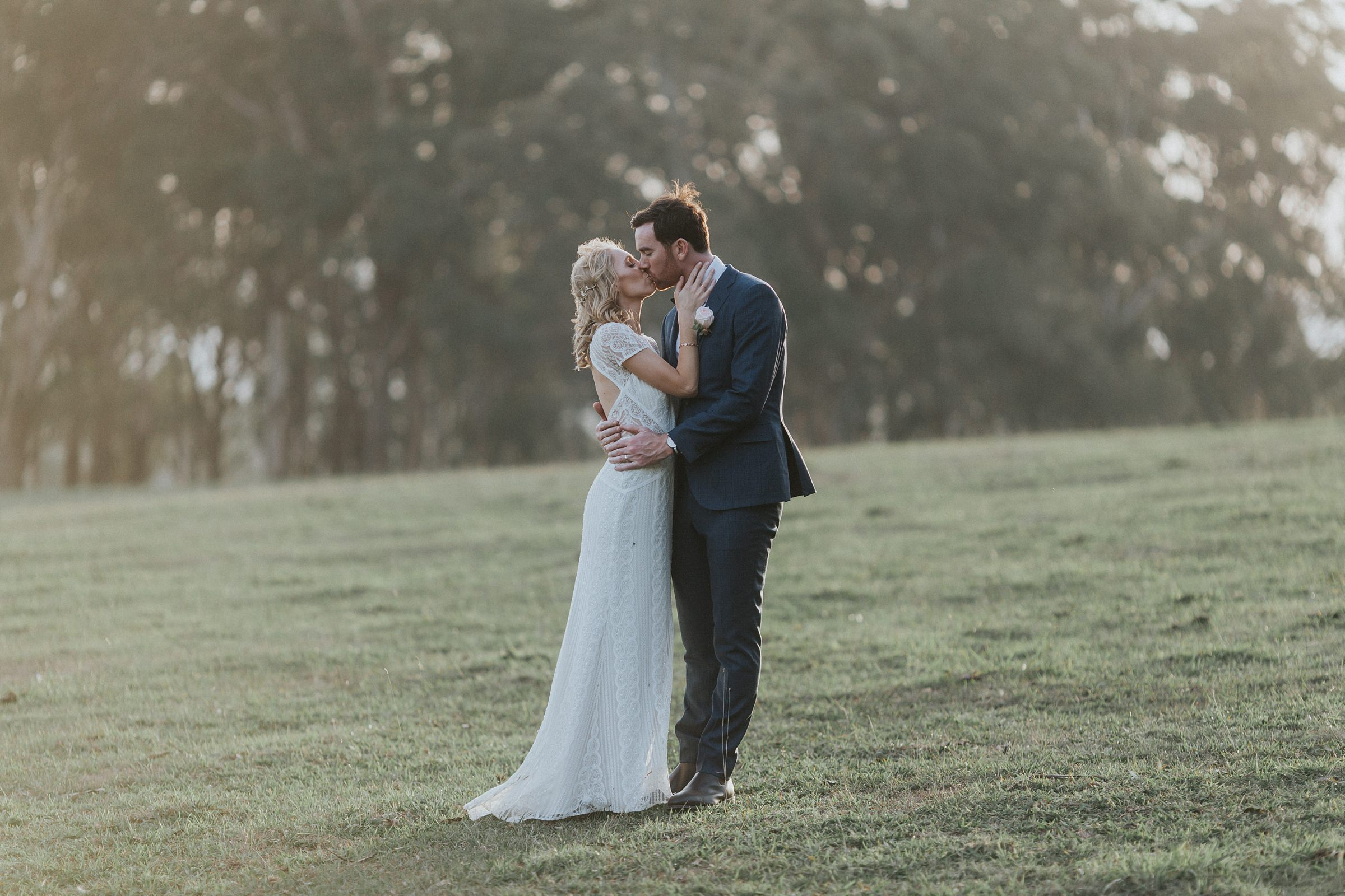passionate kiss for the bride and groom after getting married in the southern highlands