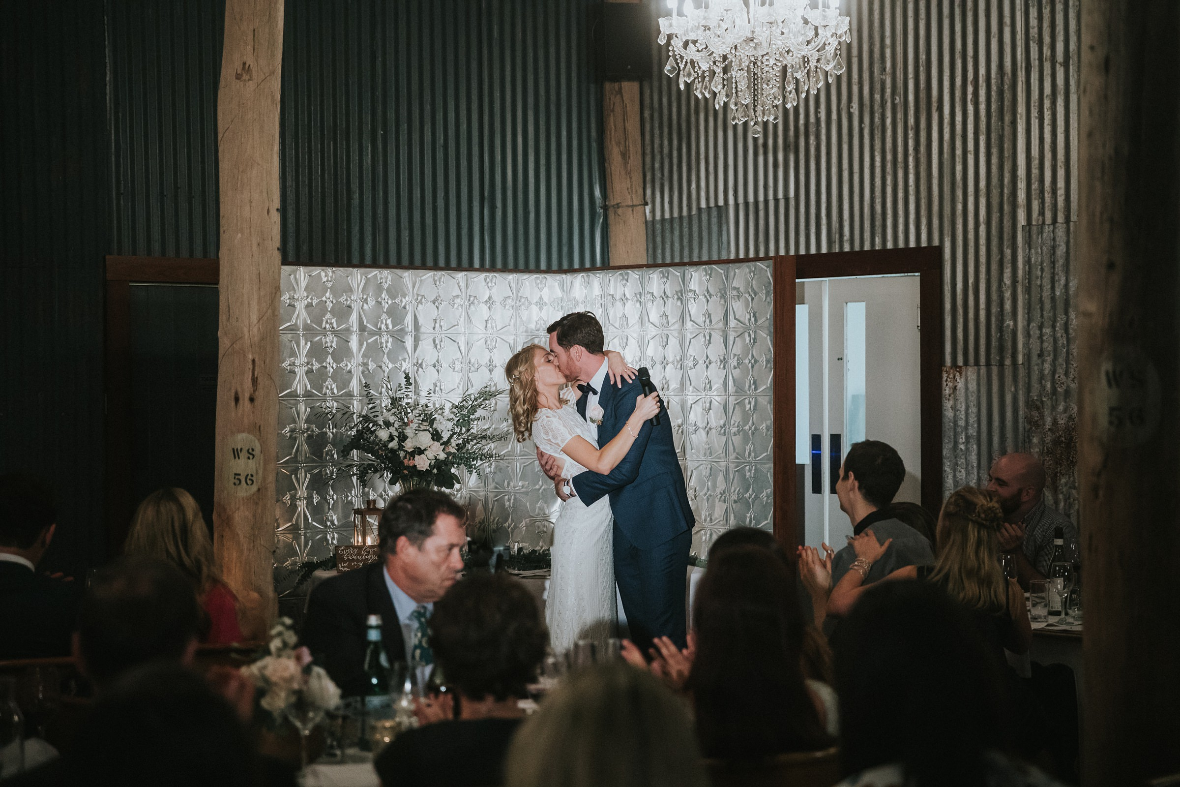 passionate kiss for the bride and groom photographs by jonathan david