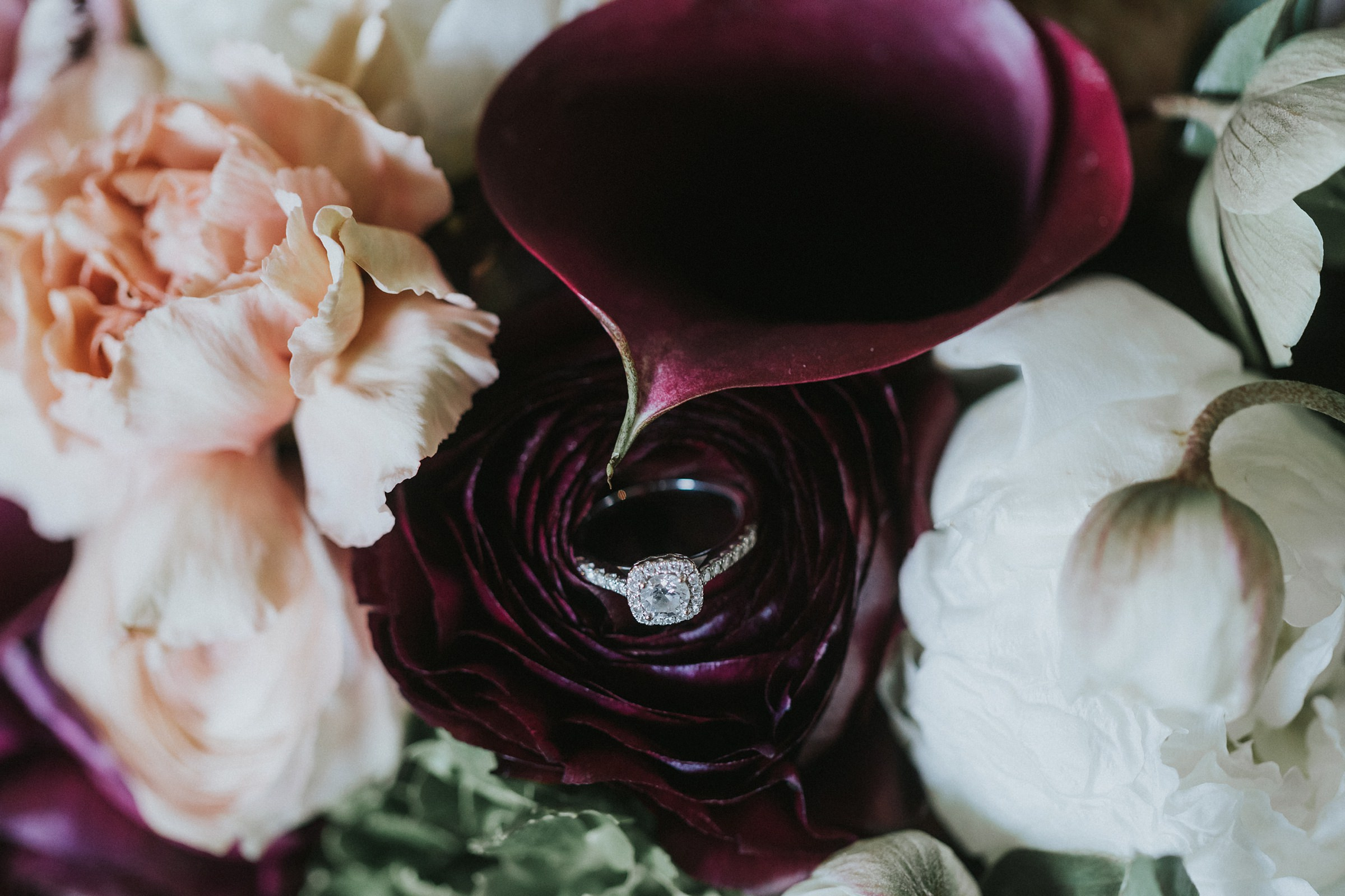 wedding ring in brides bouquet at the coach house