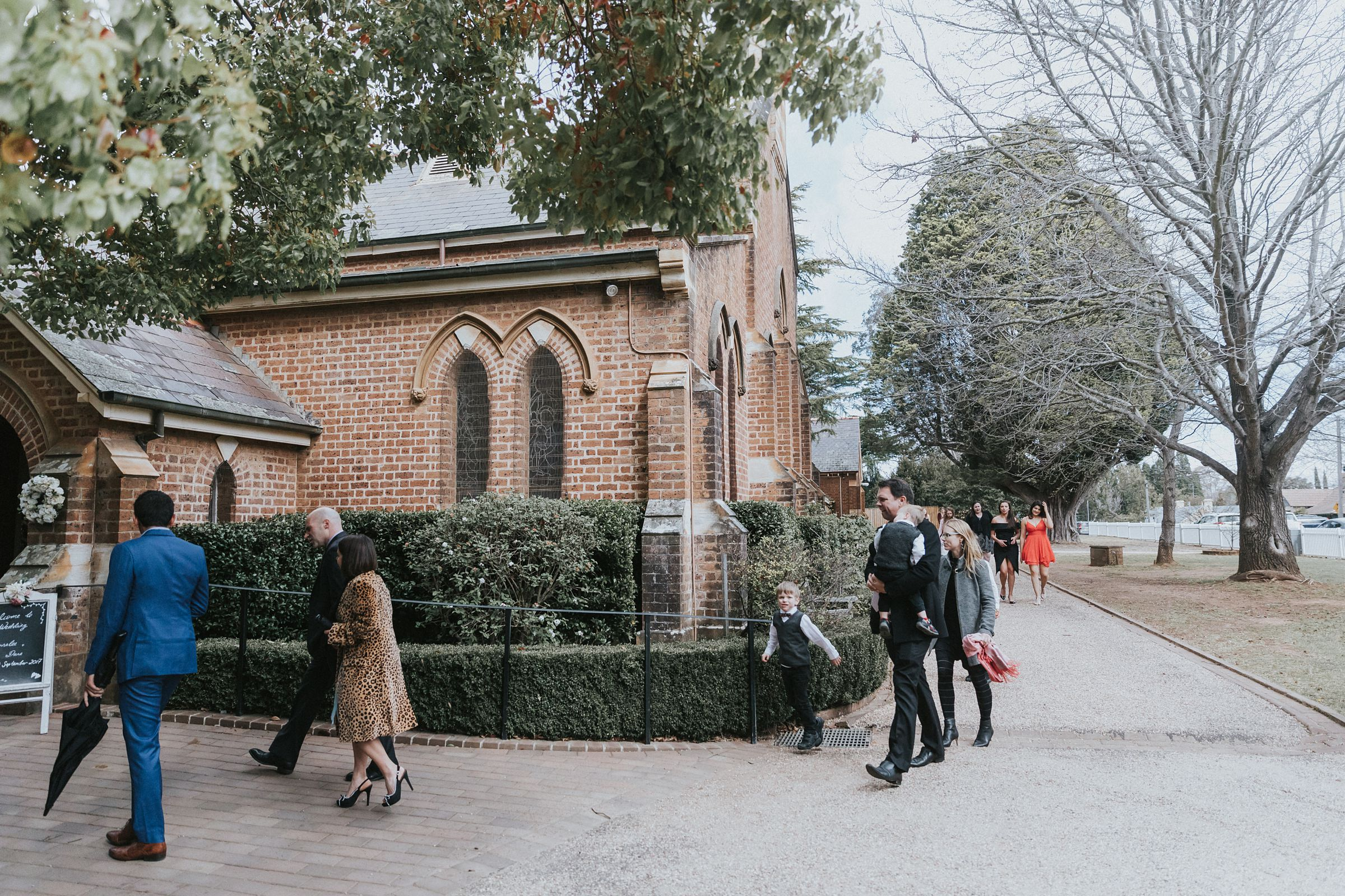 guests arriving at wedding ceremony at st jude's anglican church in bowral