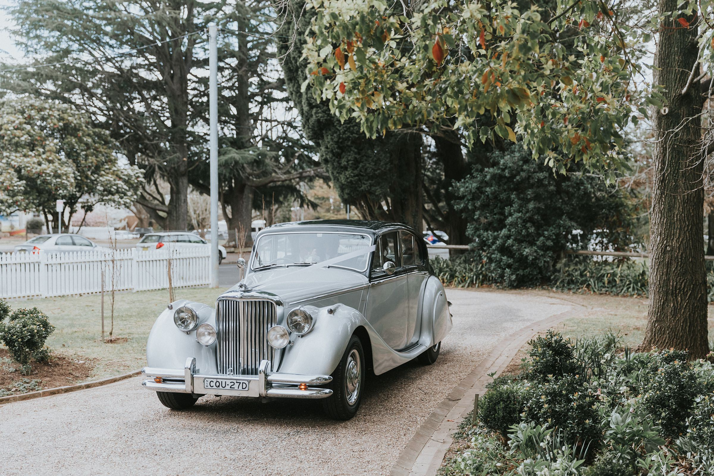 vintage rolls royce arrives at st jude's anglican church