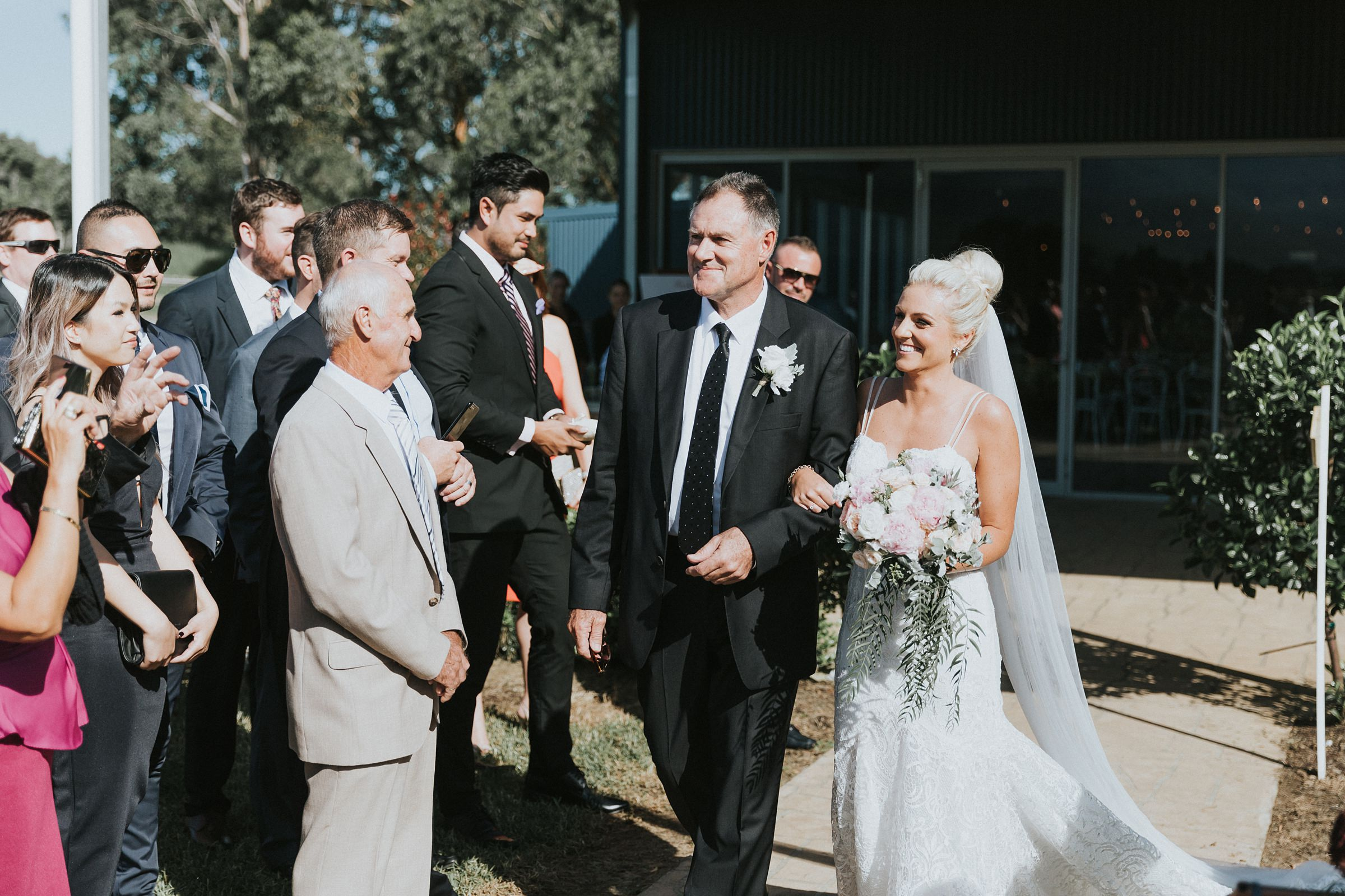bride and bride's father walking down the wedding aisle at melross farm estate
