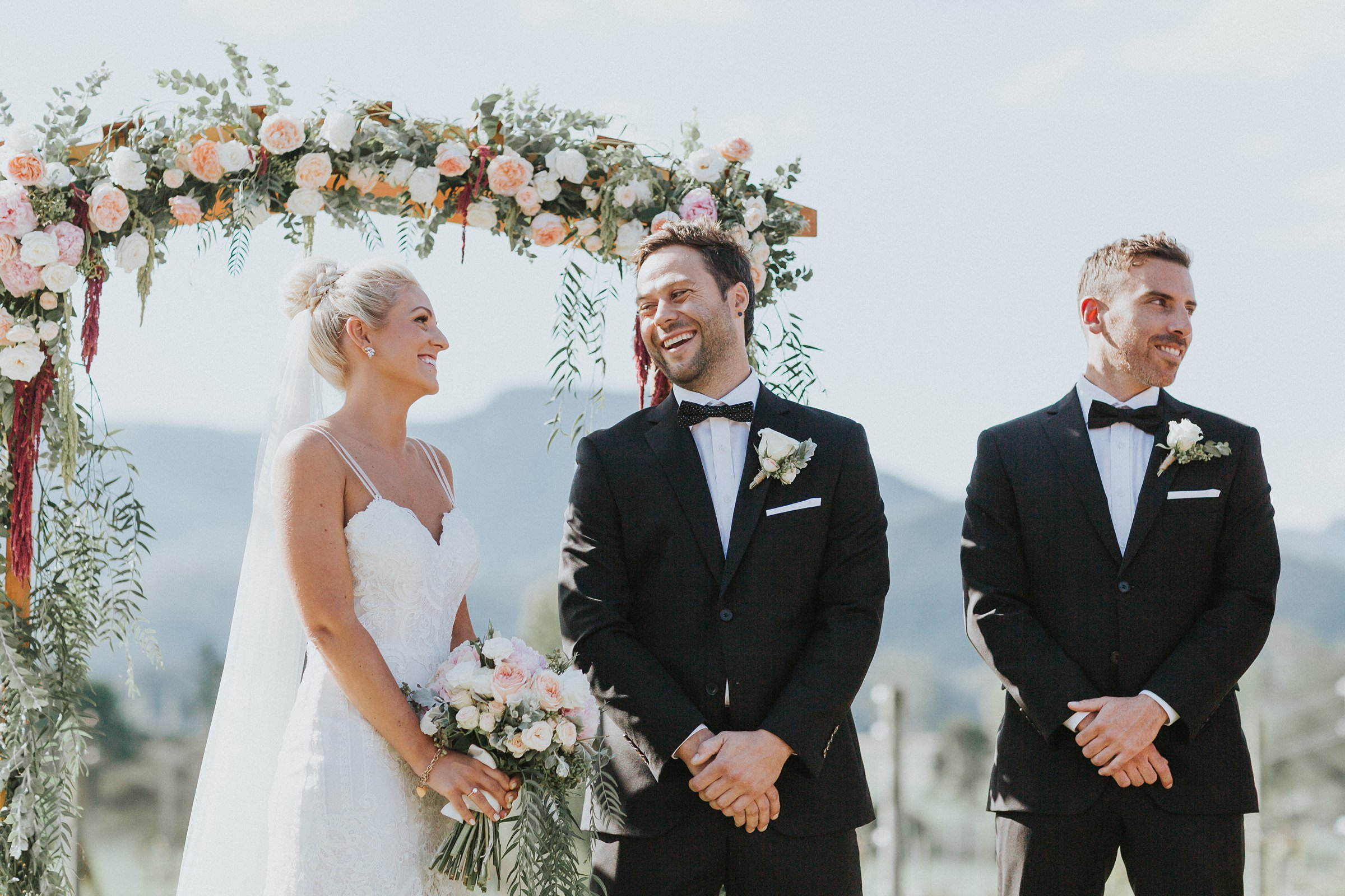 smiles and happiness from the bride and groom during wedding ceremony