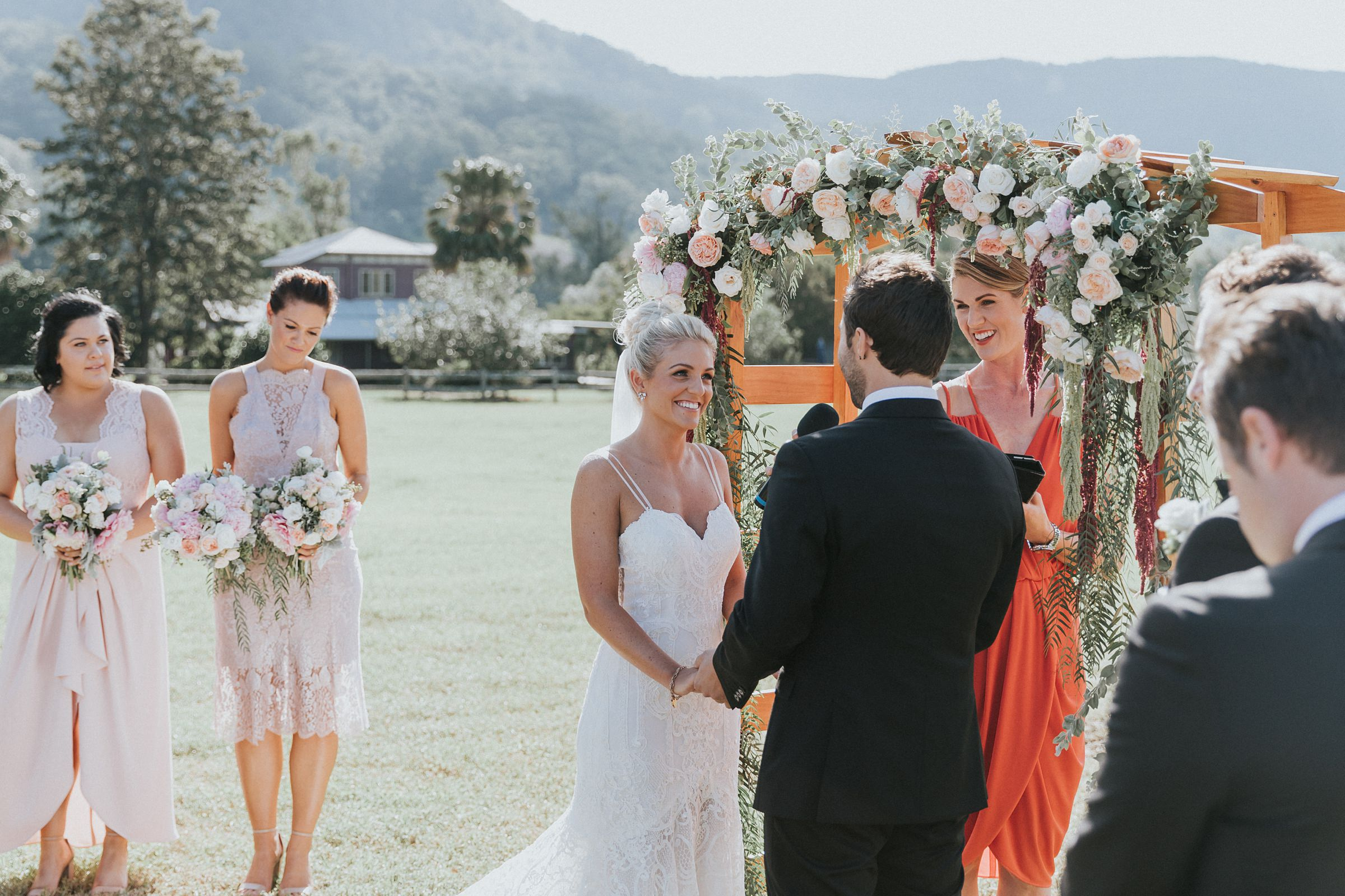 beautiful bride exchanges wedding rings at kangaroo valley wedding