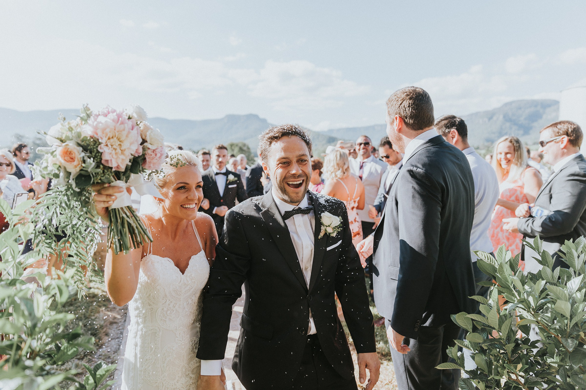 emotional groom is joyous during wedding recessional