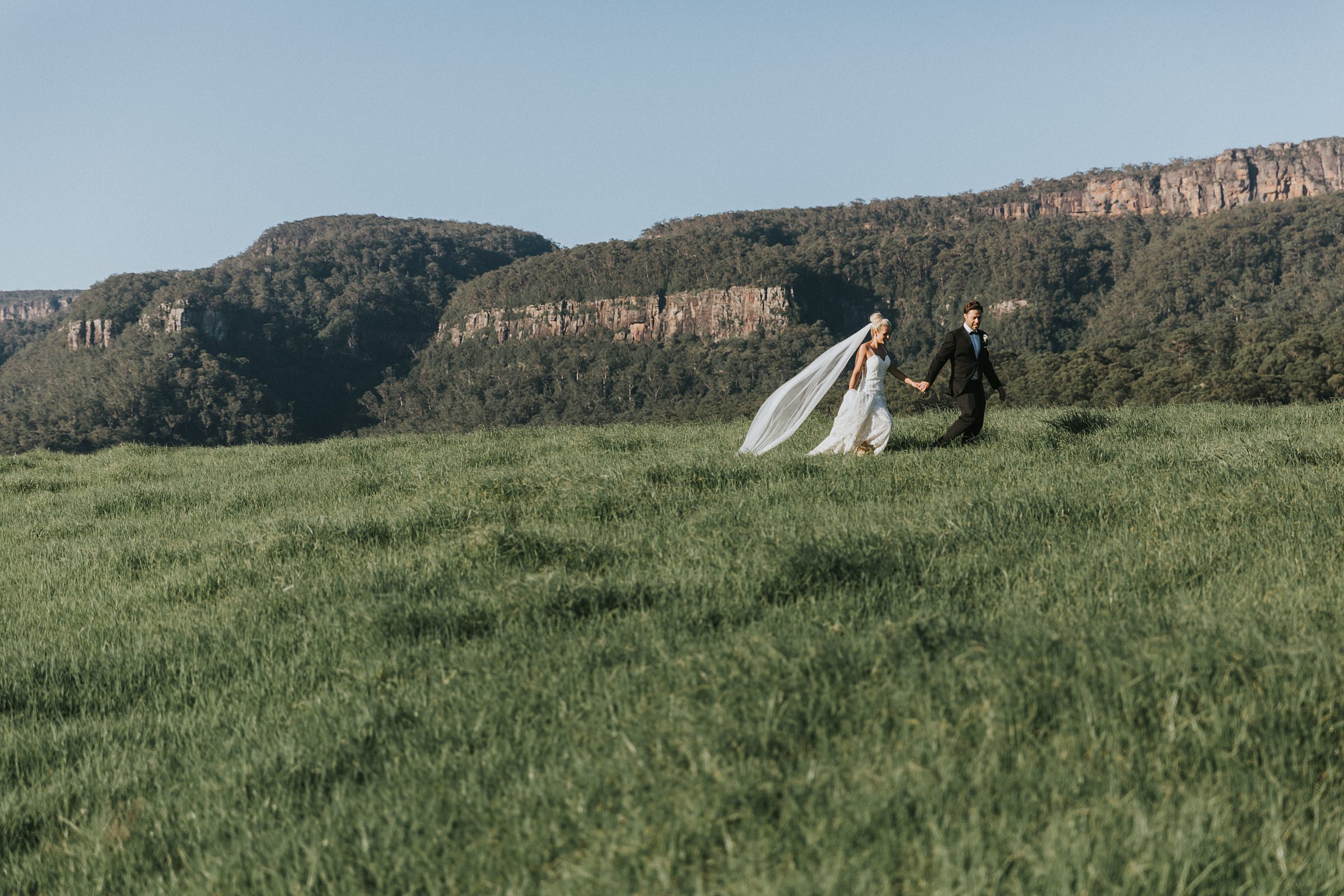 dramatic landscape photography with the bride and groom on wedding day