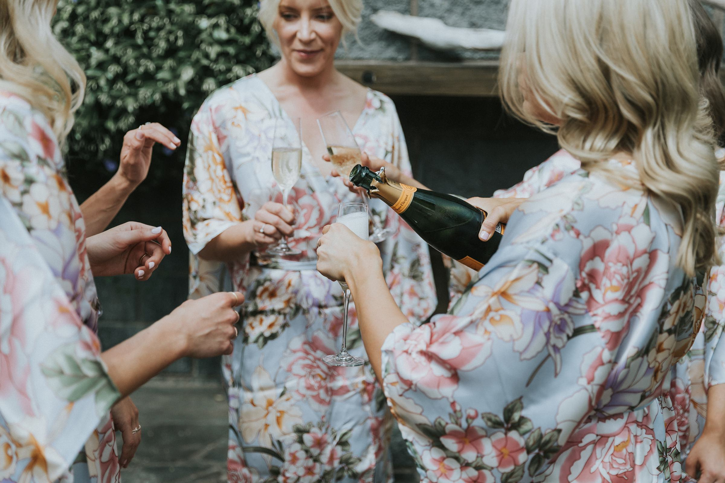 pouring a glass of champagne for tumut wedding