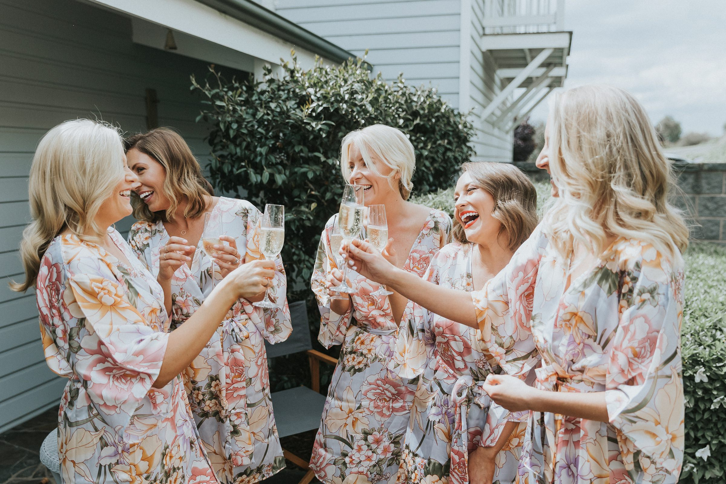 laughing with her bridesmaids at nimbo fork lodge