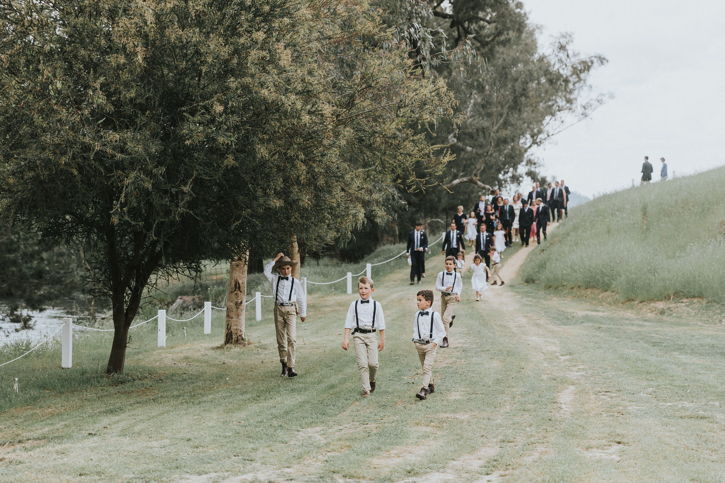 flower children walking the guests to the wedding ceremony by the tumut river
