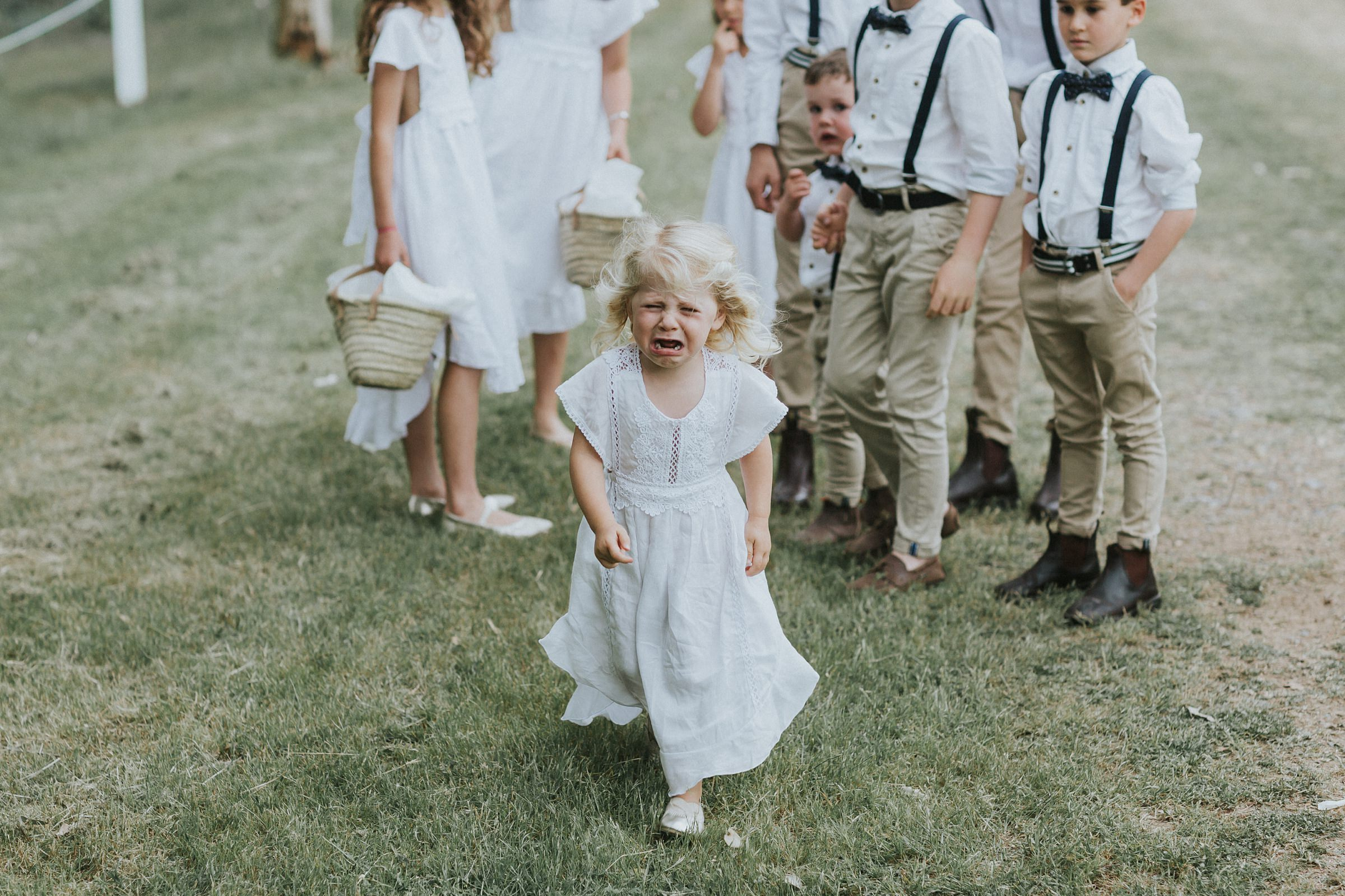 flower girl cries before ceremony starts