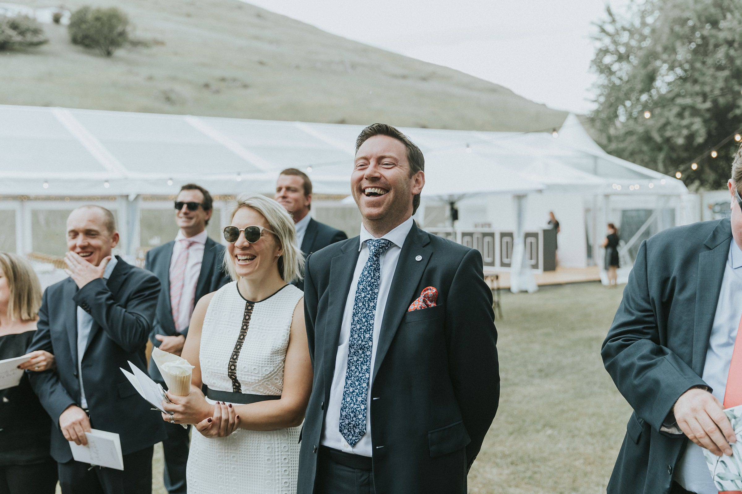 guests laughing during wedding ceremony in tumut