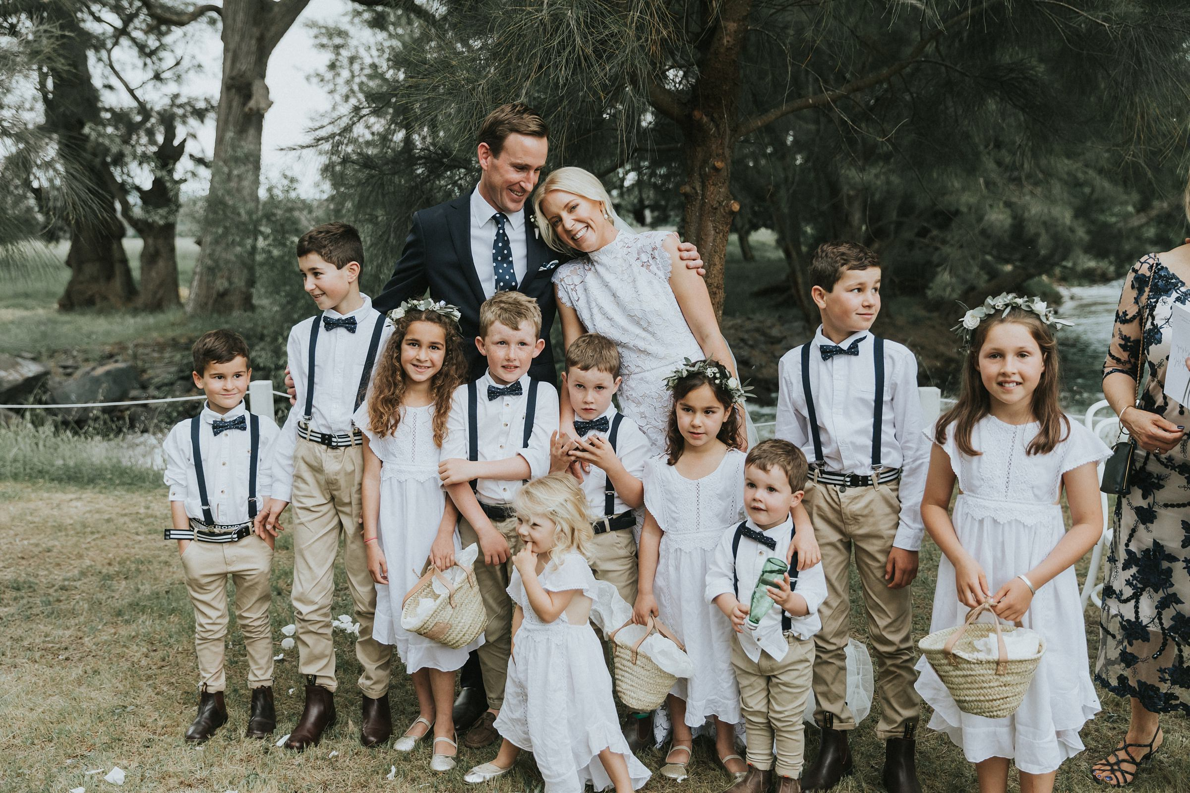 kids circle around the bride and groom after wedding ceremony
