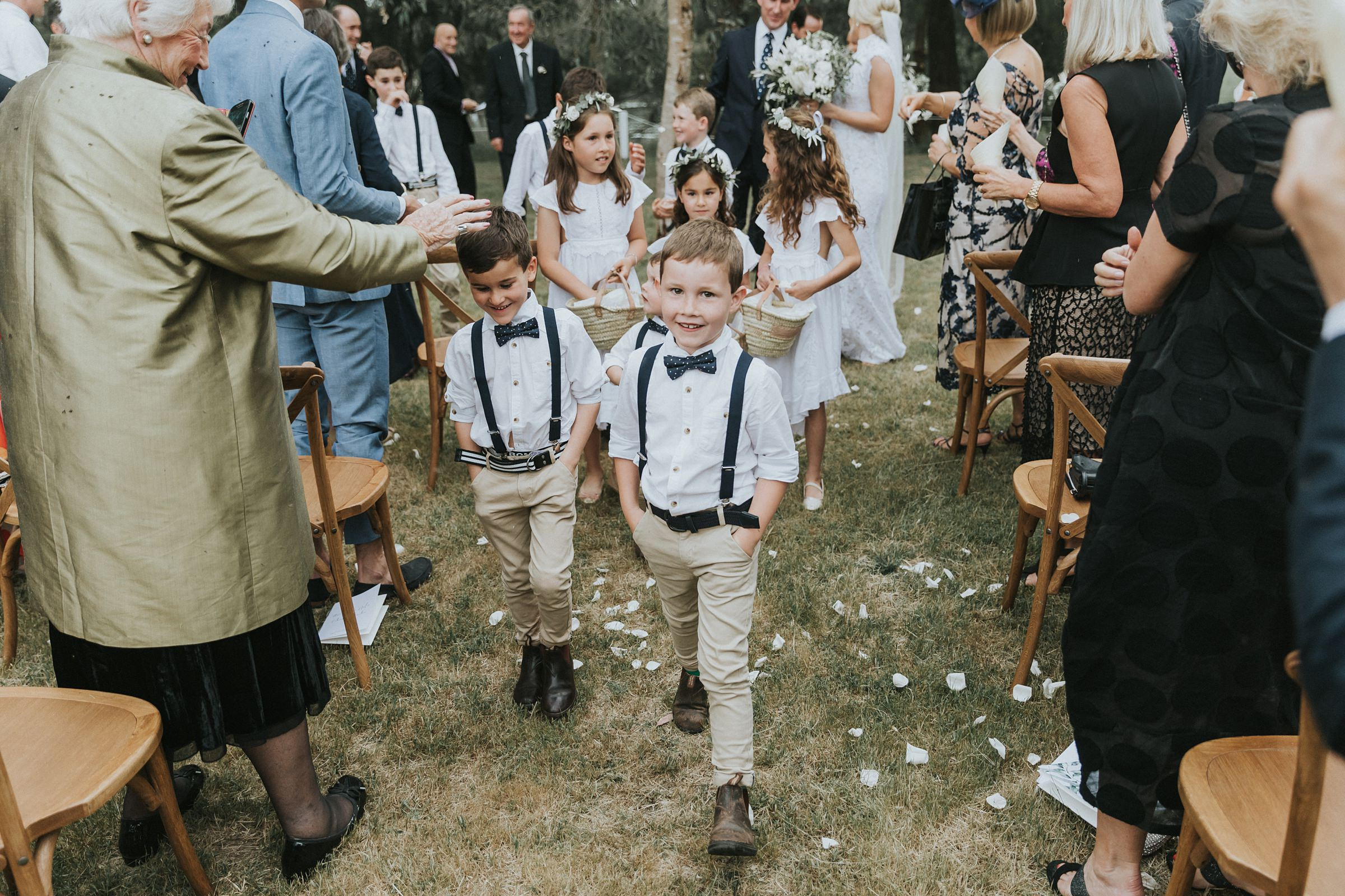 walking down the aisle with kids by your side at country wedding