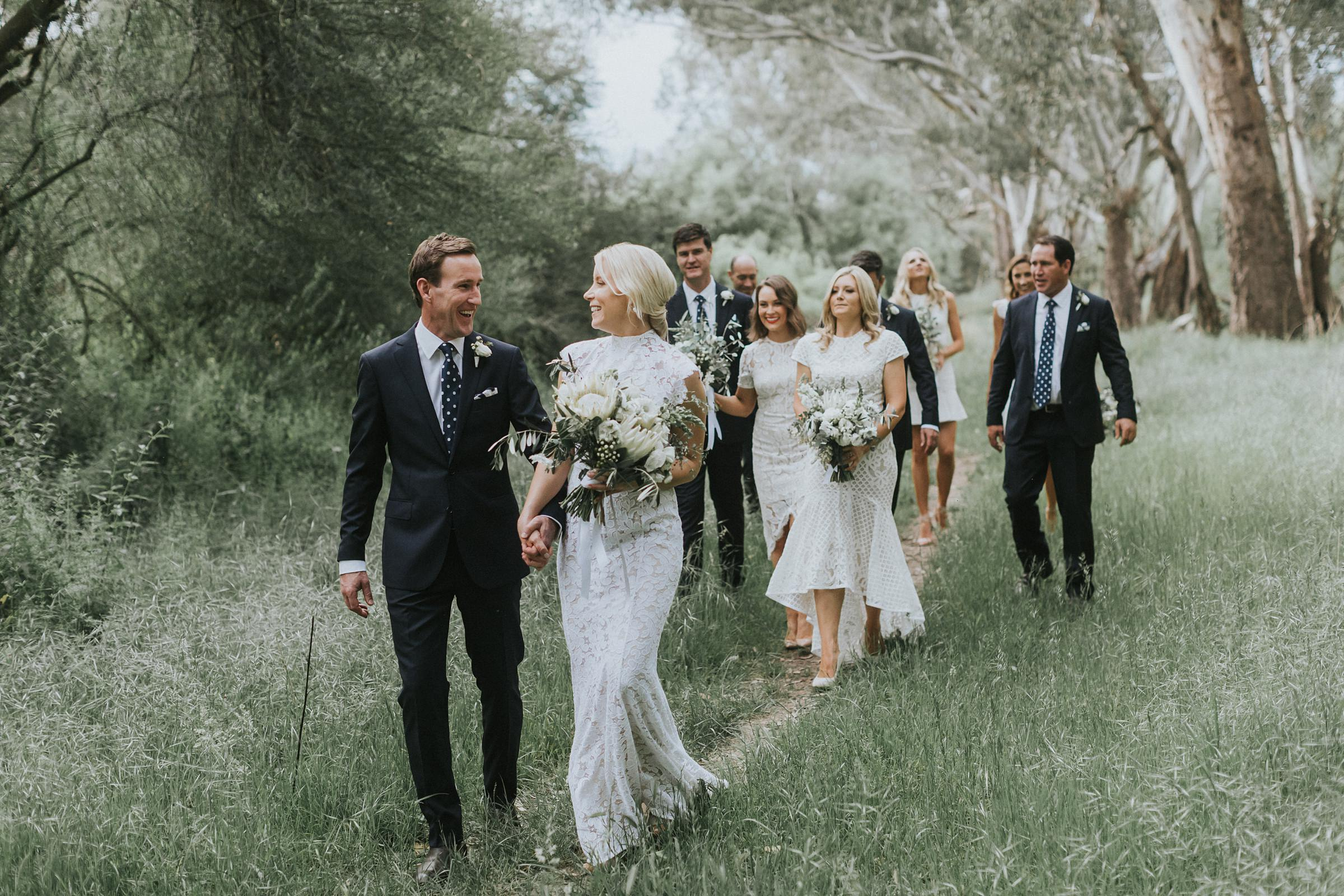 bride and groom walking with their bridal party at nimdo fork