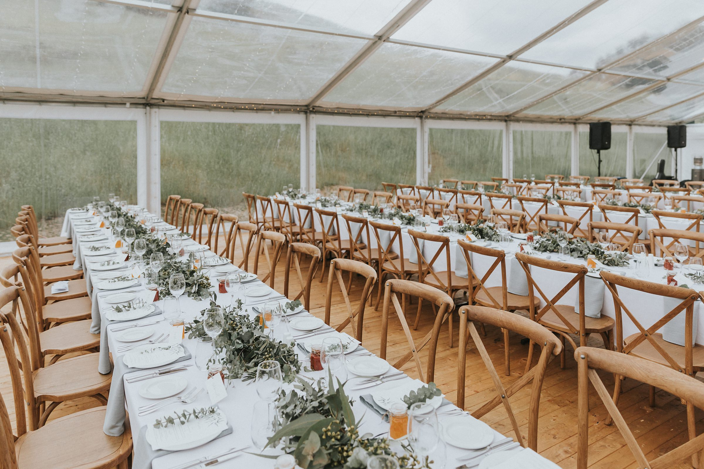 long tables at wedding reception white top venues