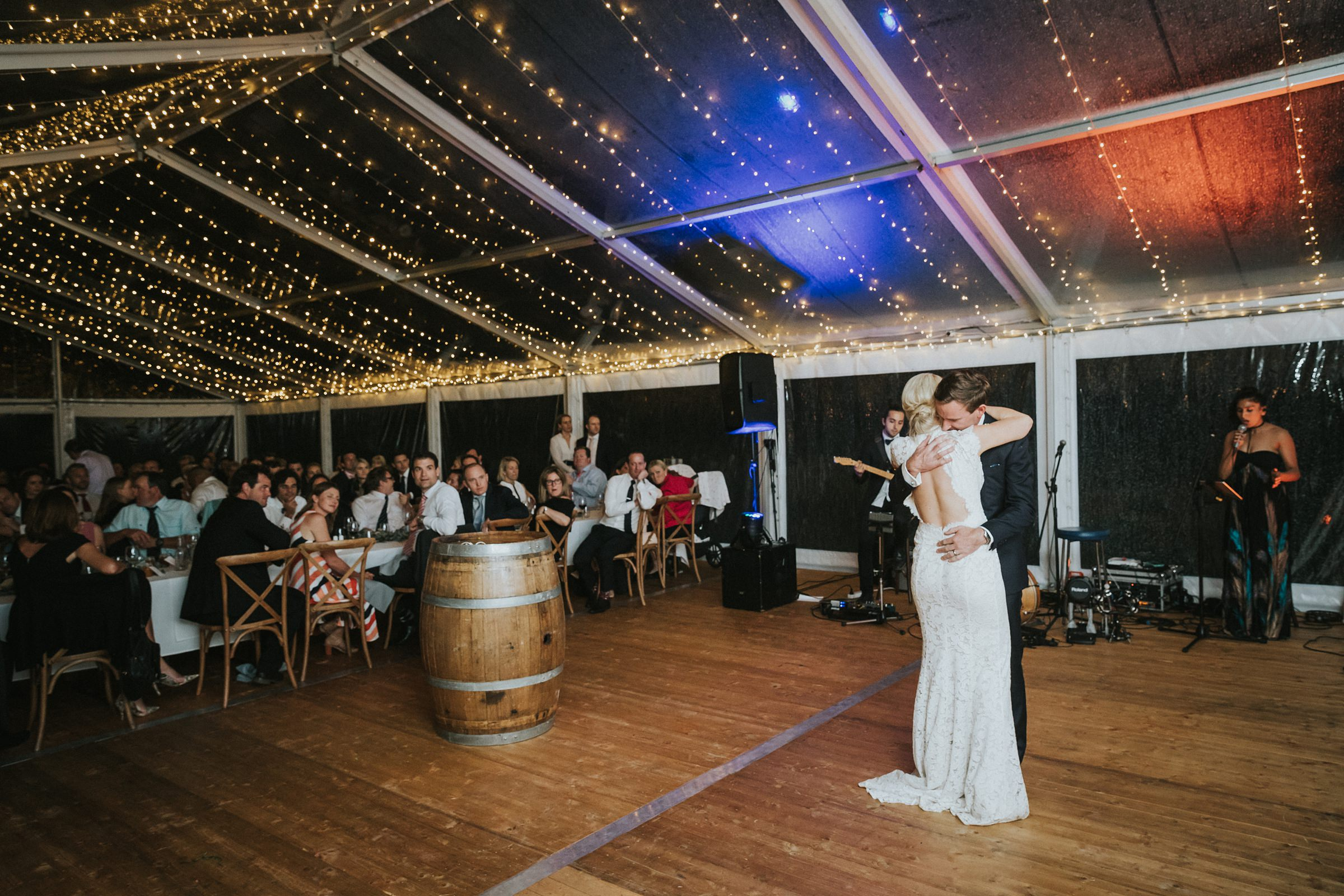 bridal waltz under the fairy lights in the marquee at nimbo fork lodge