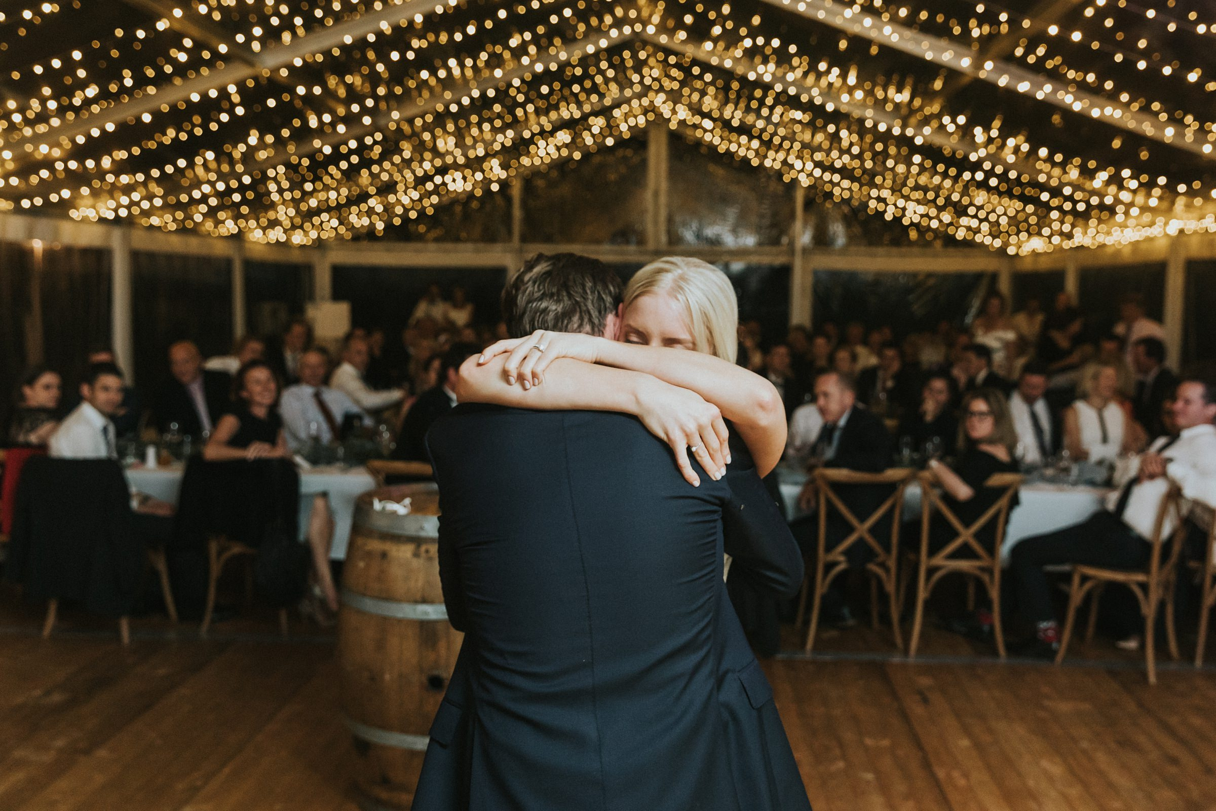 bride and groom embrace on the dance floor during bridal waltz