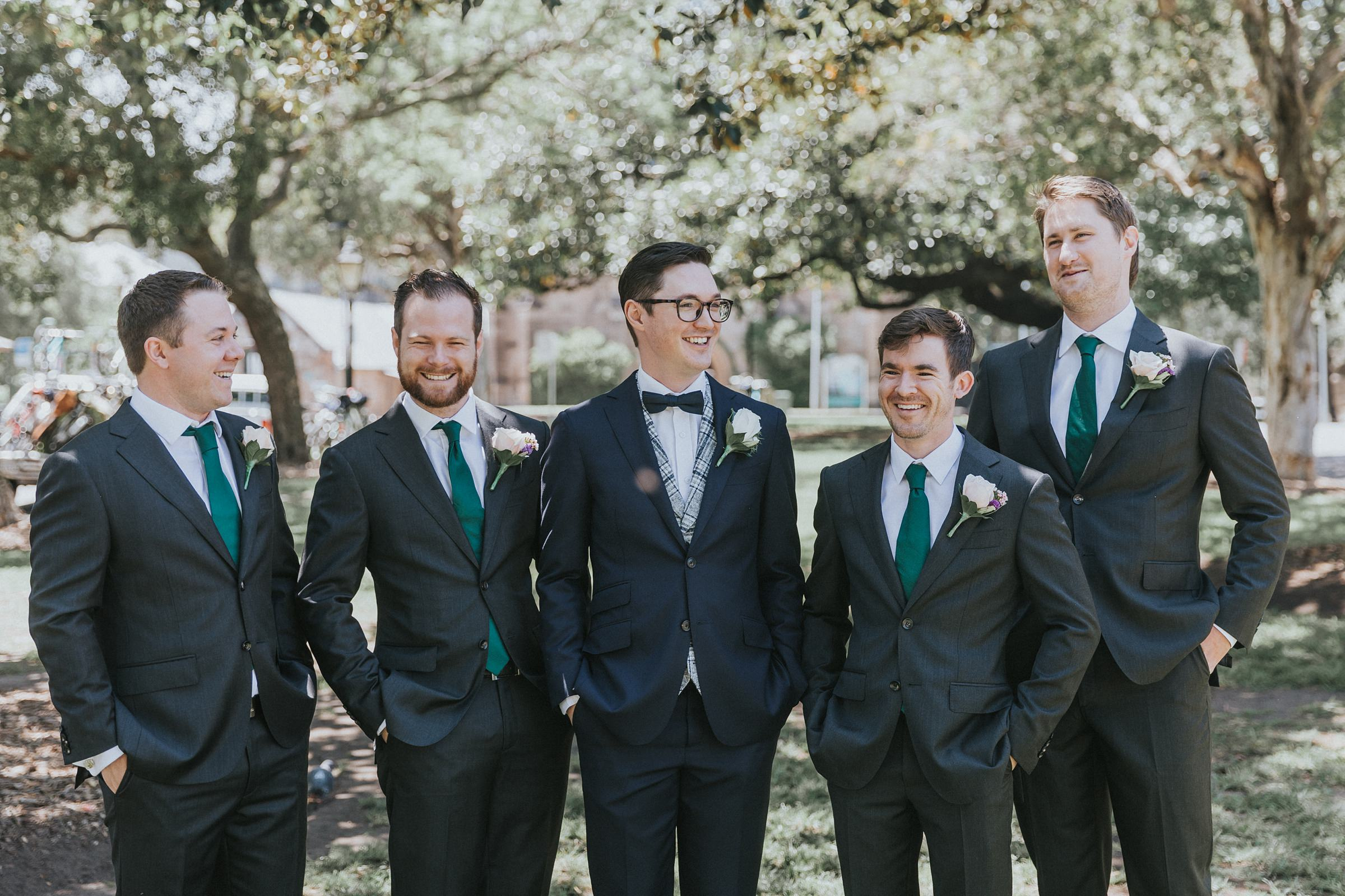 groom with his groomsmen in the rocks