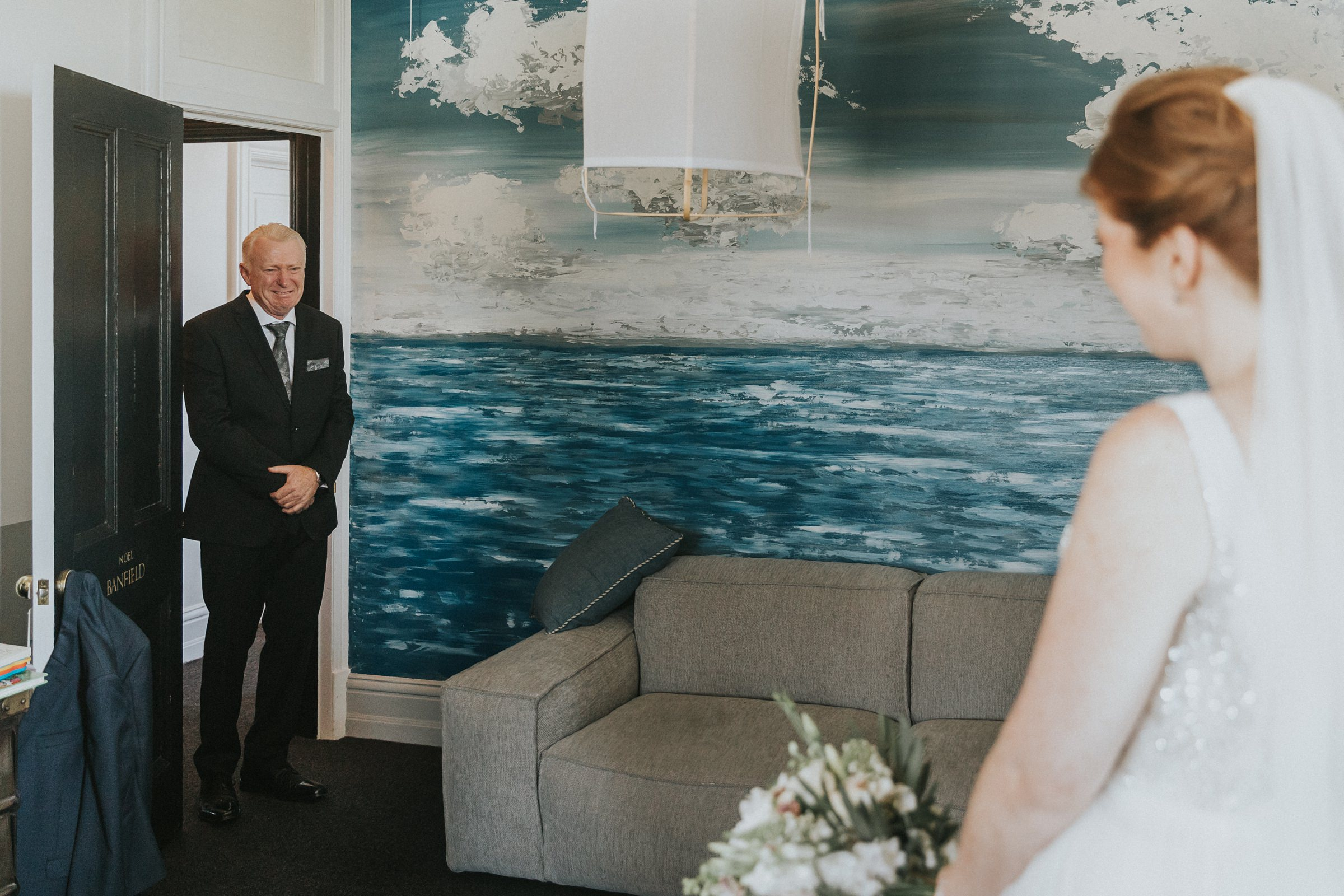 father of the bride sees his daughter in her wedding dress for the first time in sydney