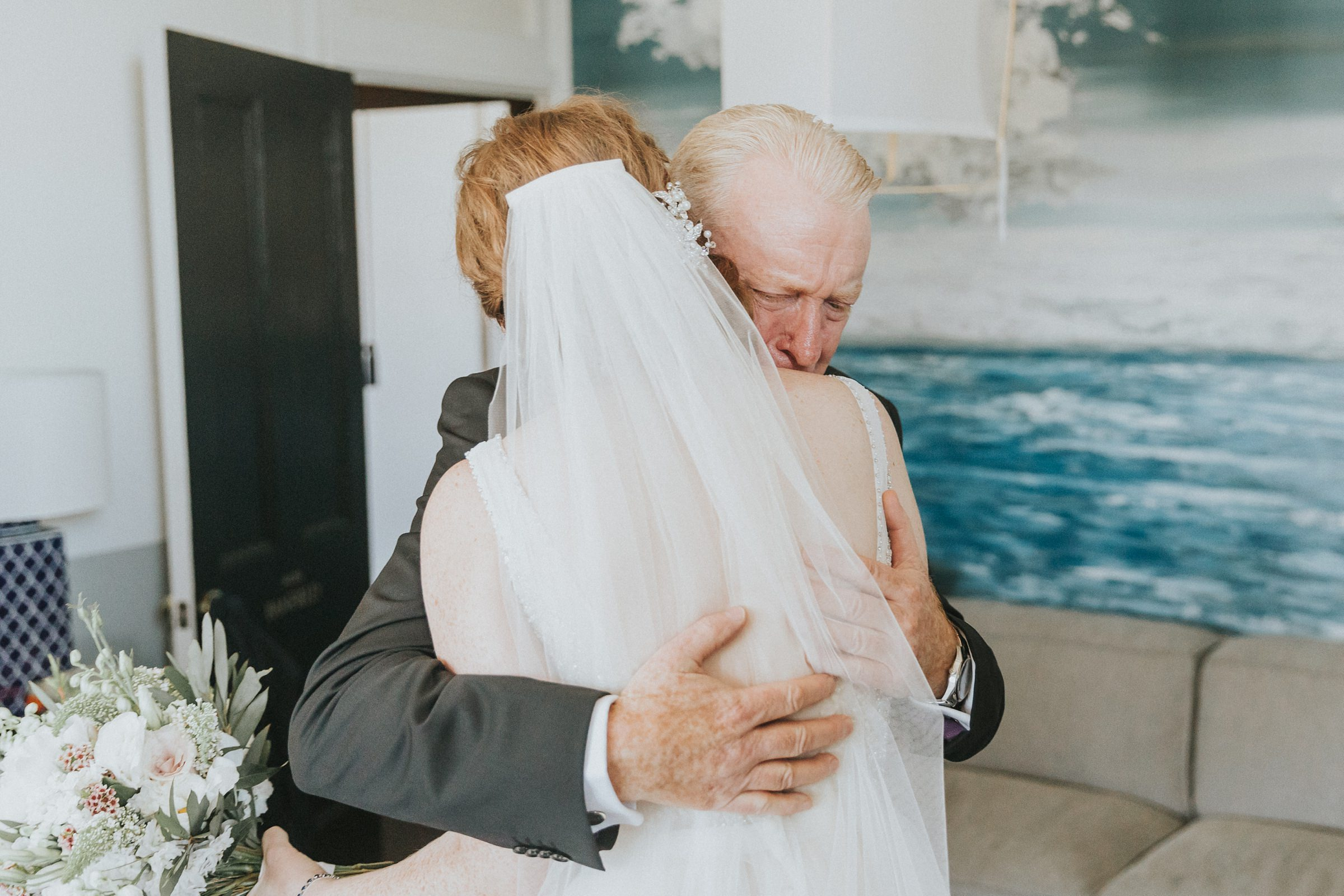 emotional father of the bride hugs his daughter